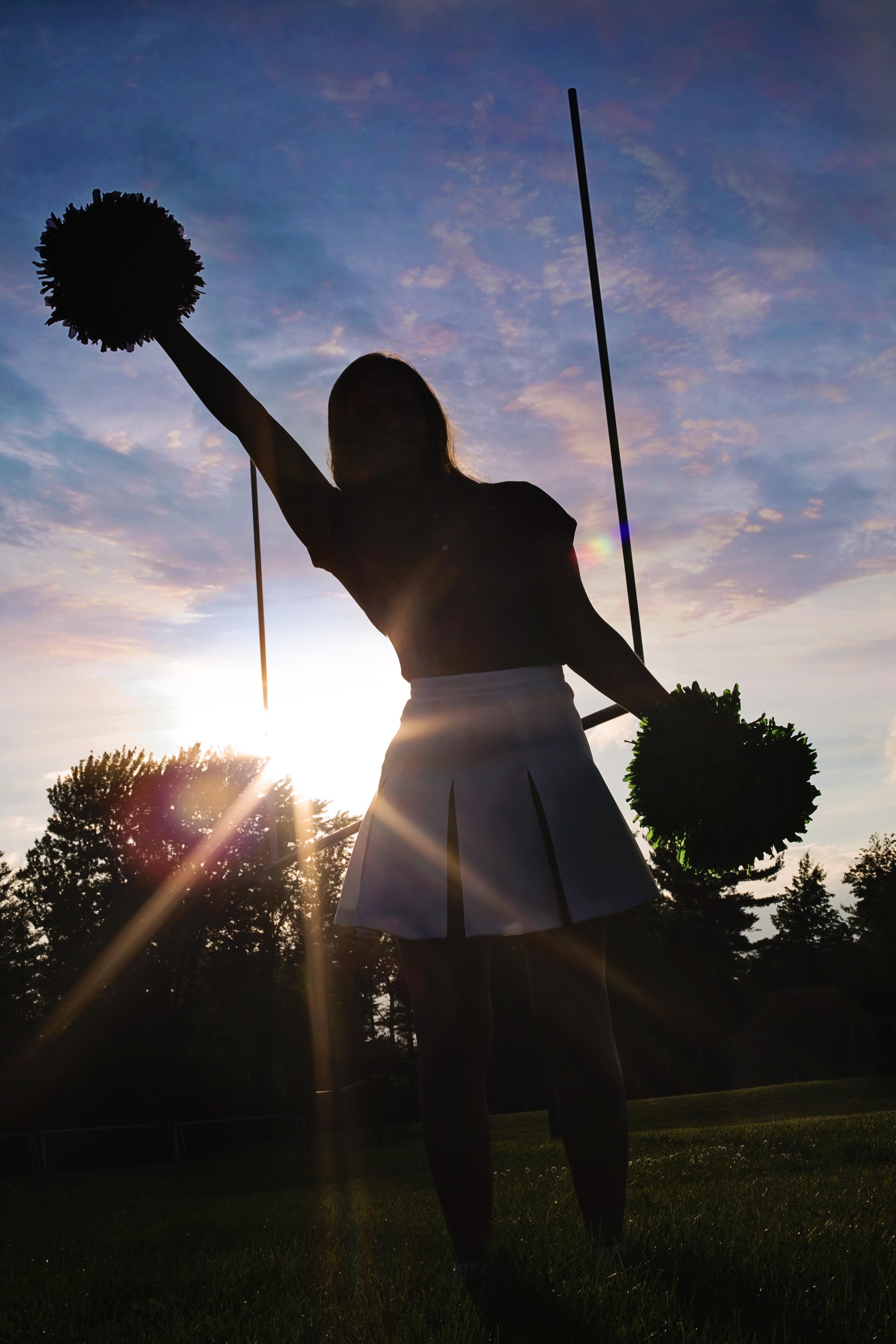 Cheerleader practicing photo