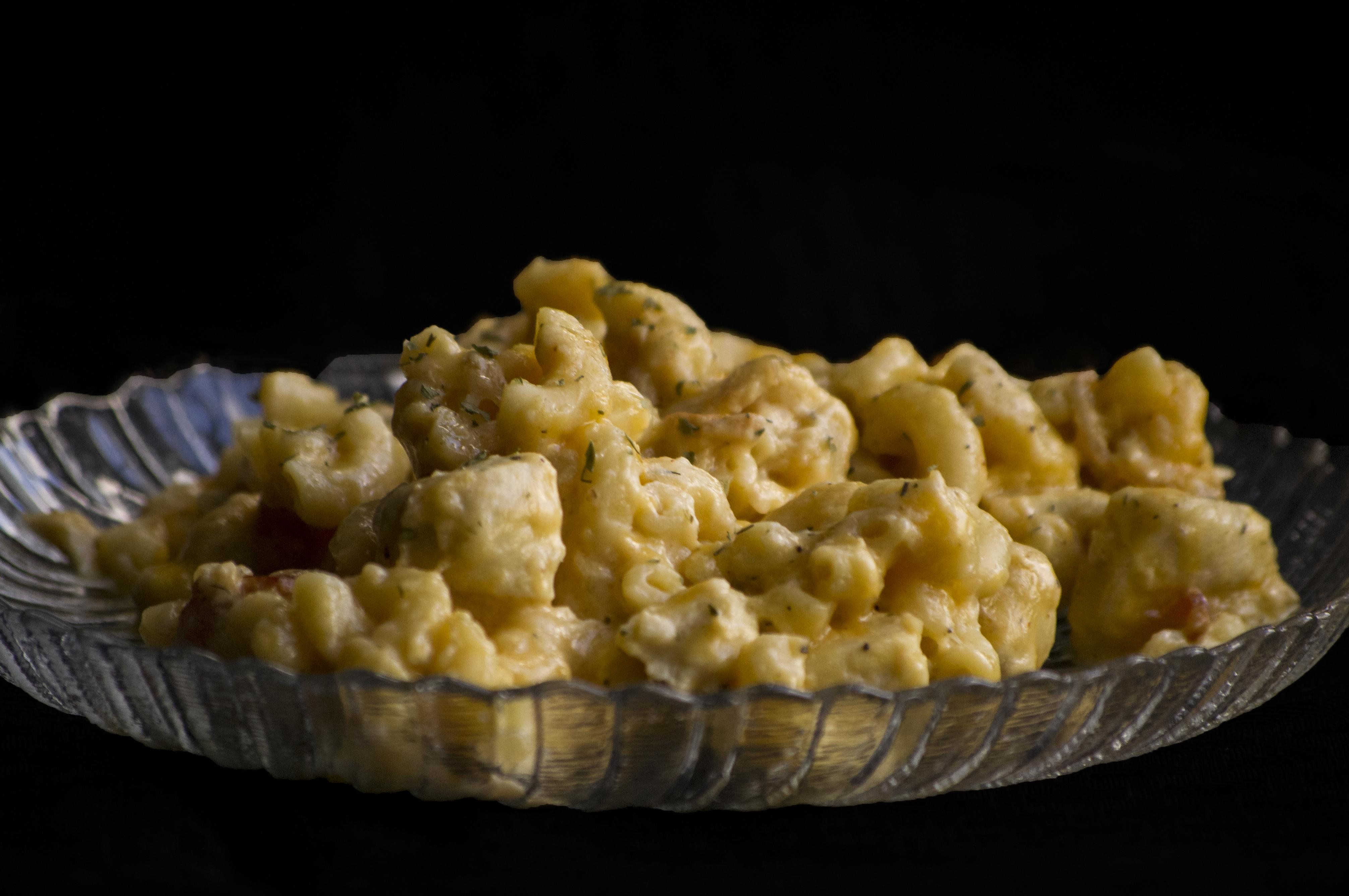 Cheesy pasta on plate photo