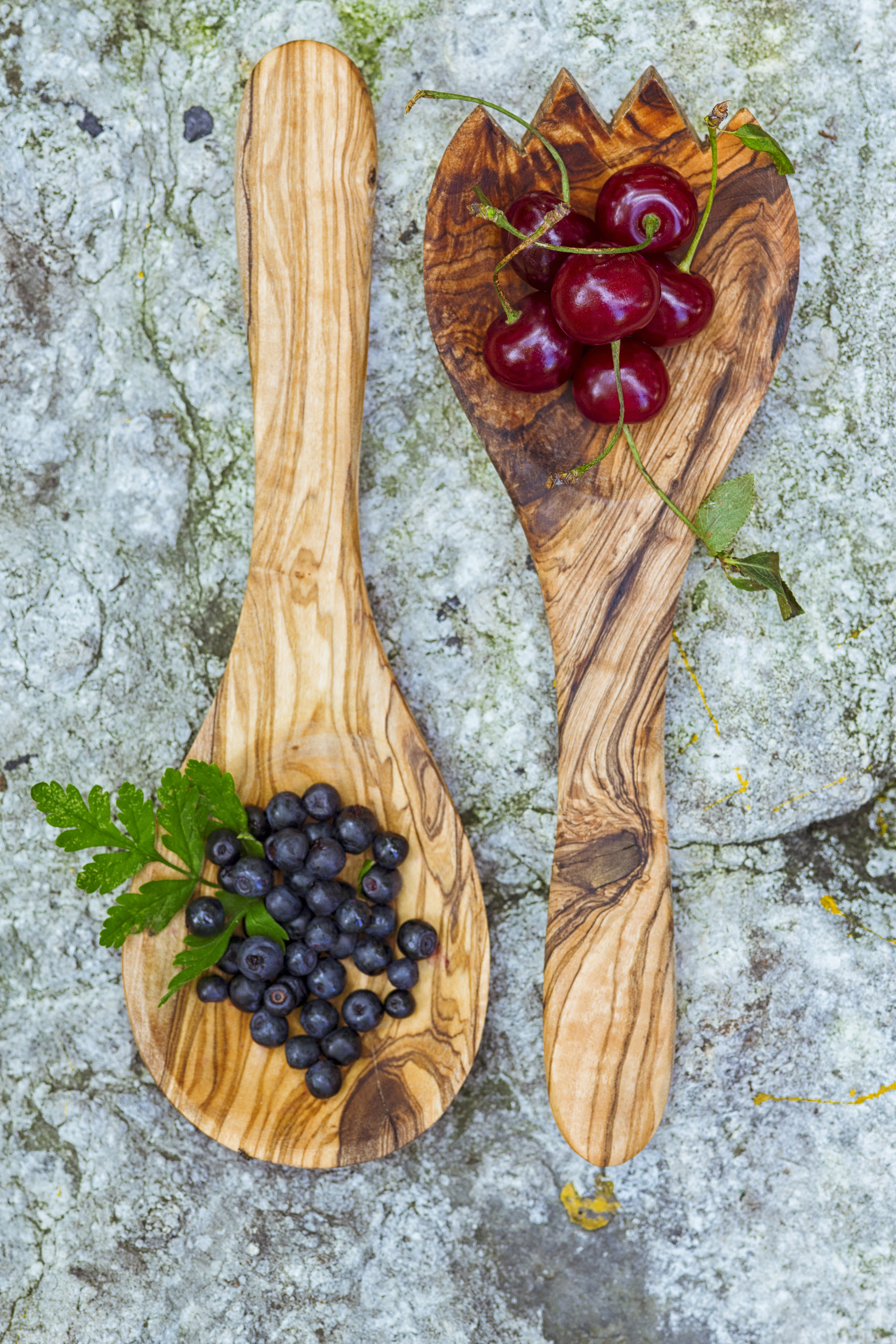 Cherries and blueberries in wooden spoon photo