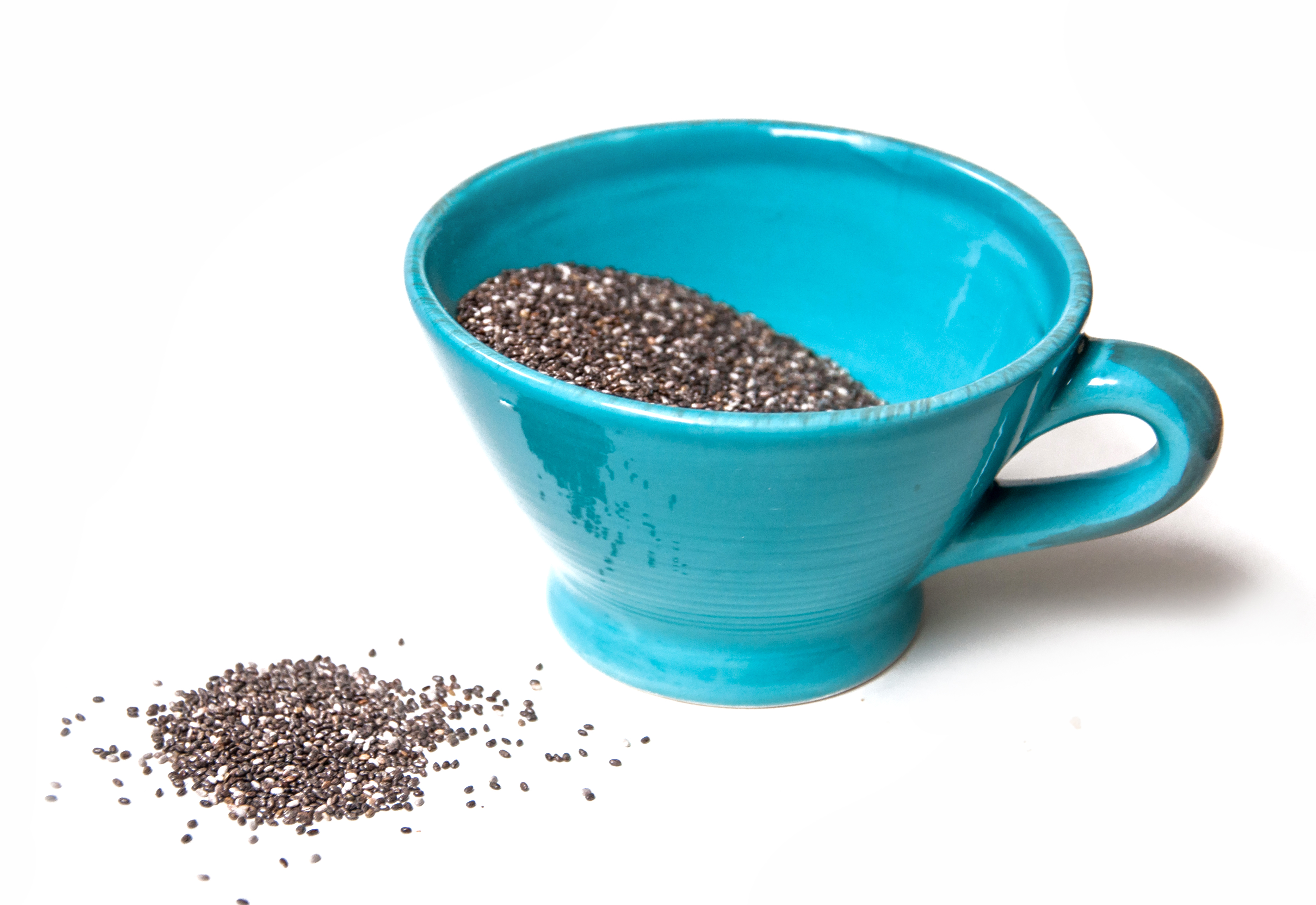 Chia seeds isolated on white photo