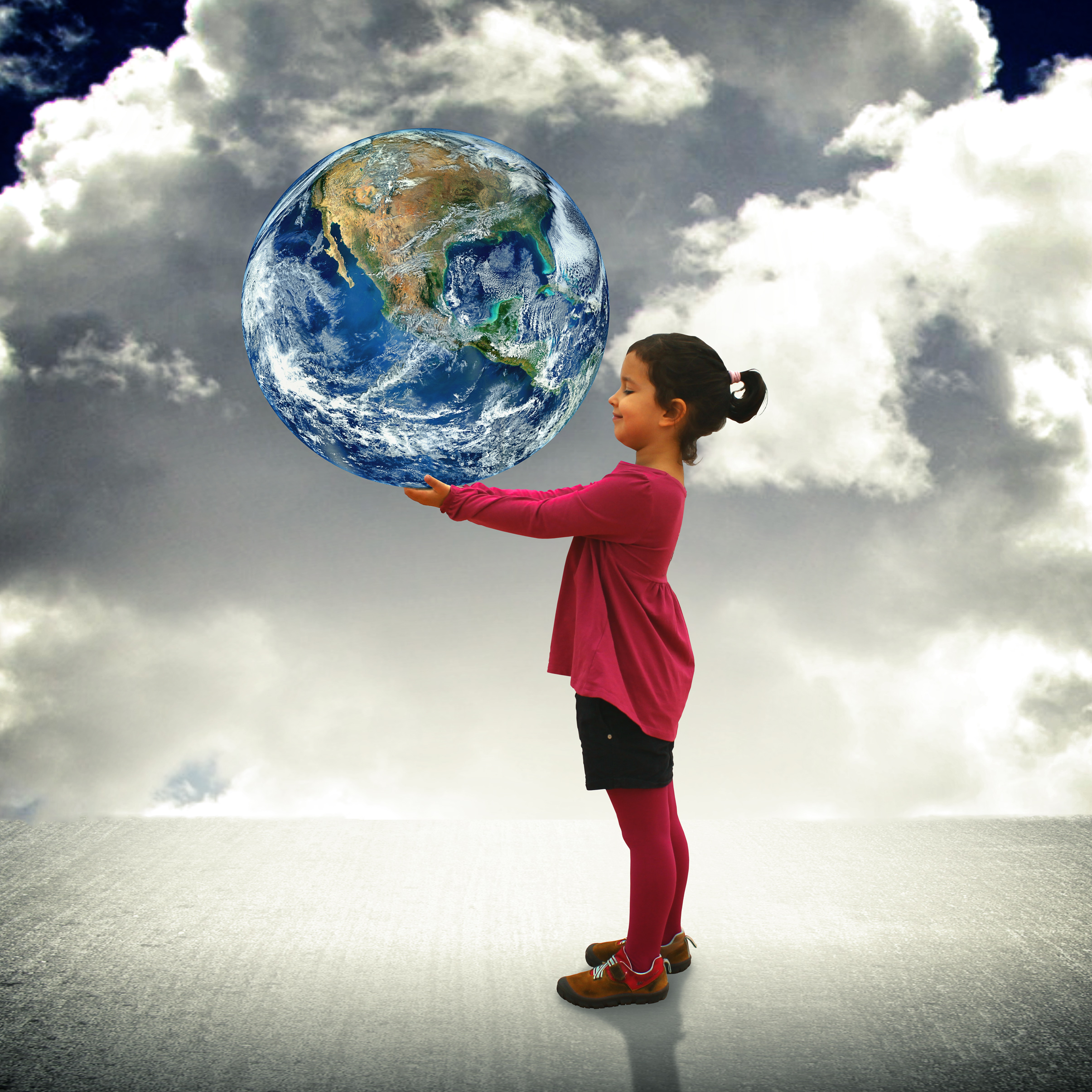 Child holding the world in her hands photo