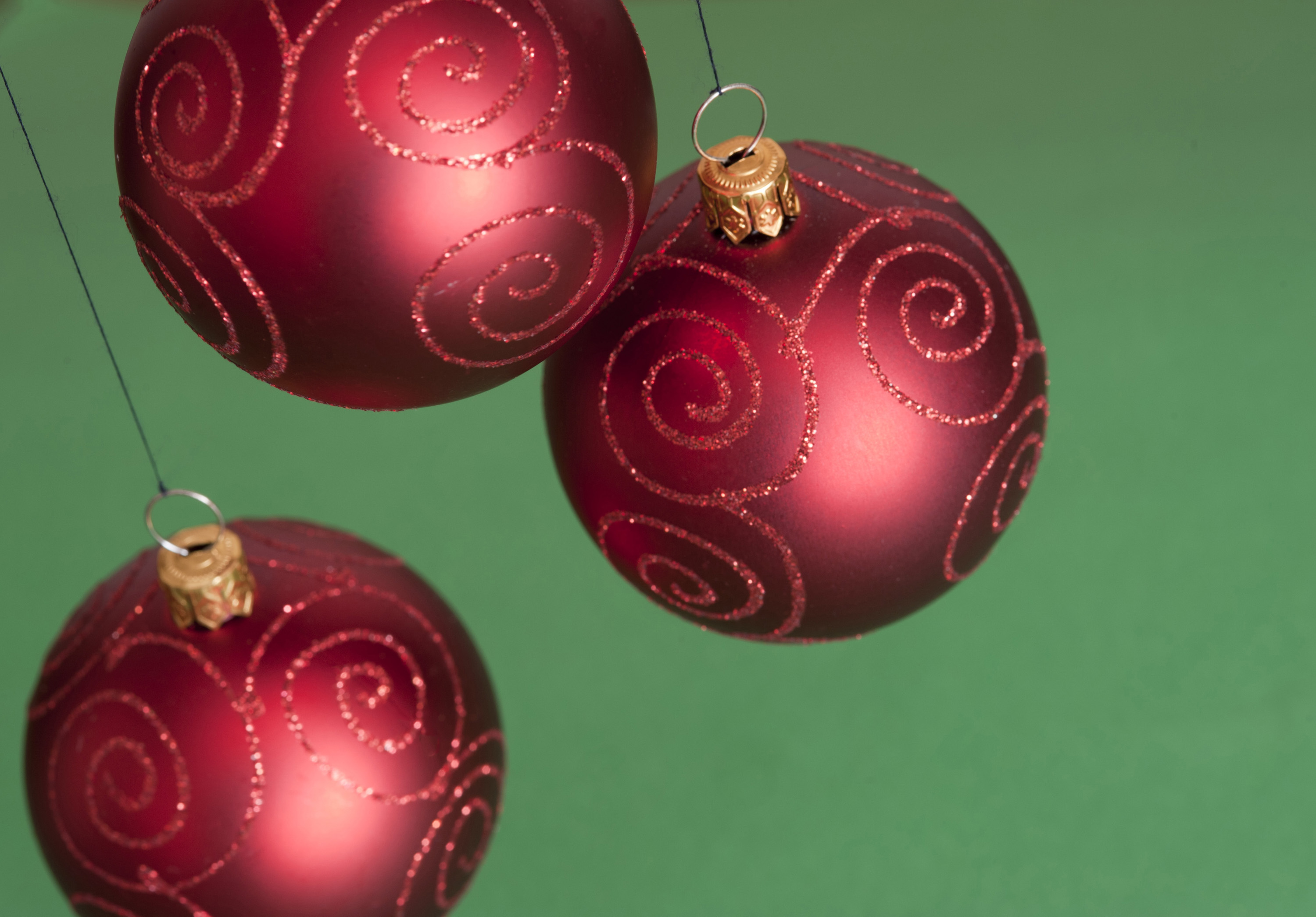 Photo of Three red Christmas balls hanging   Free christmas images
