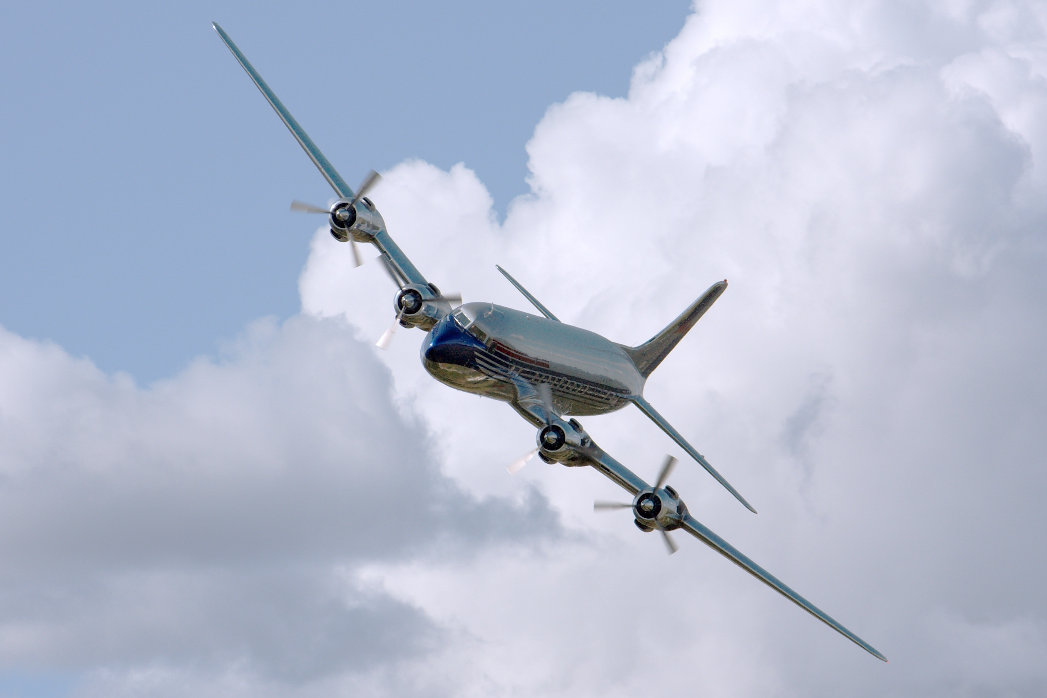 Chrome airplane flying during daytime photo