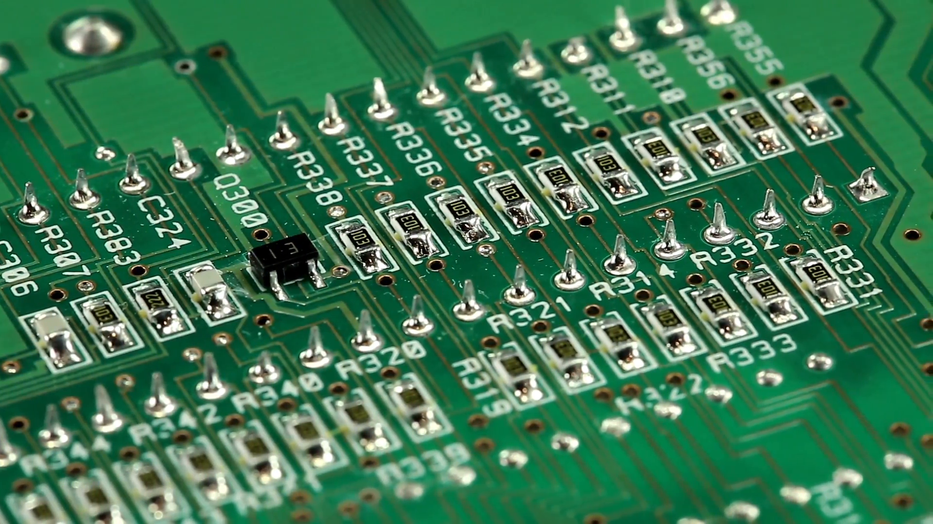 Green microcircuit chip with electronic components. Close-up of ...