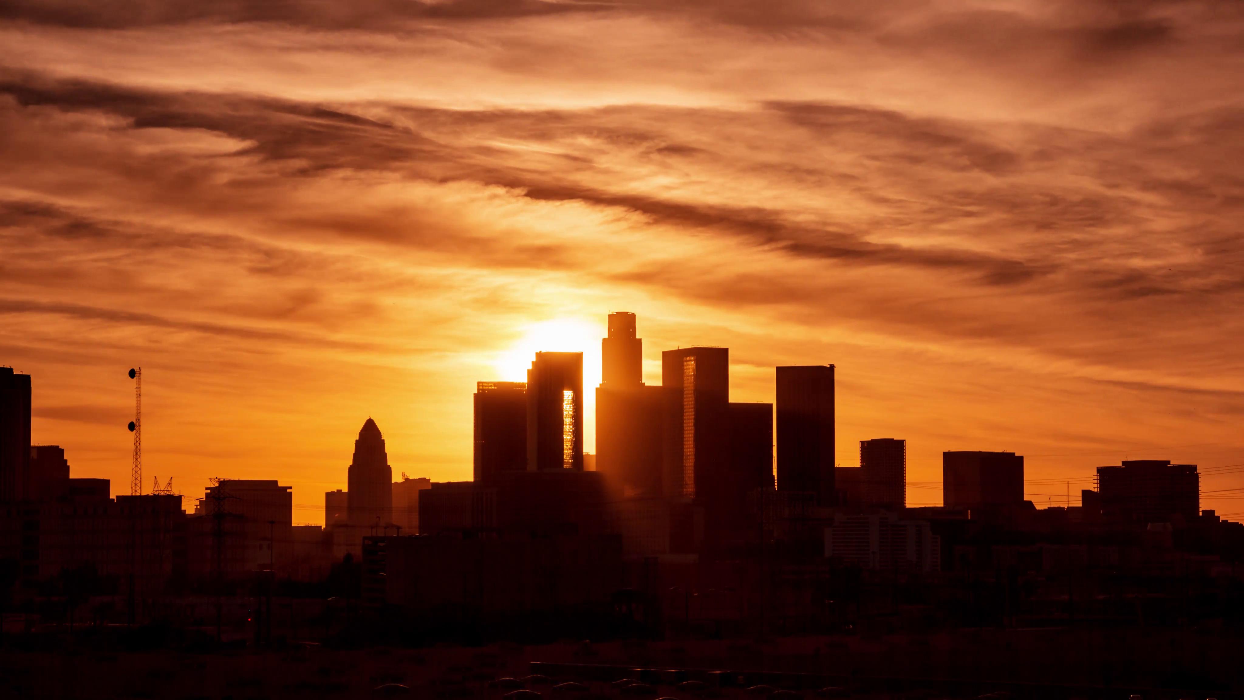 Beautiful sun setting behind downtown Los Angeles city skyline ...