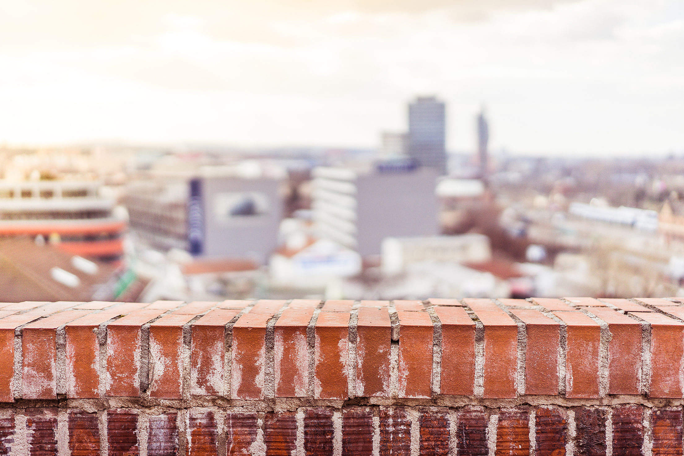 Empty Brick Wall with Blurred City View Background Free Stock Photo ...