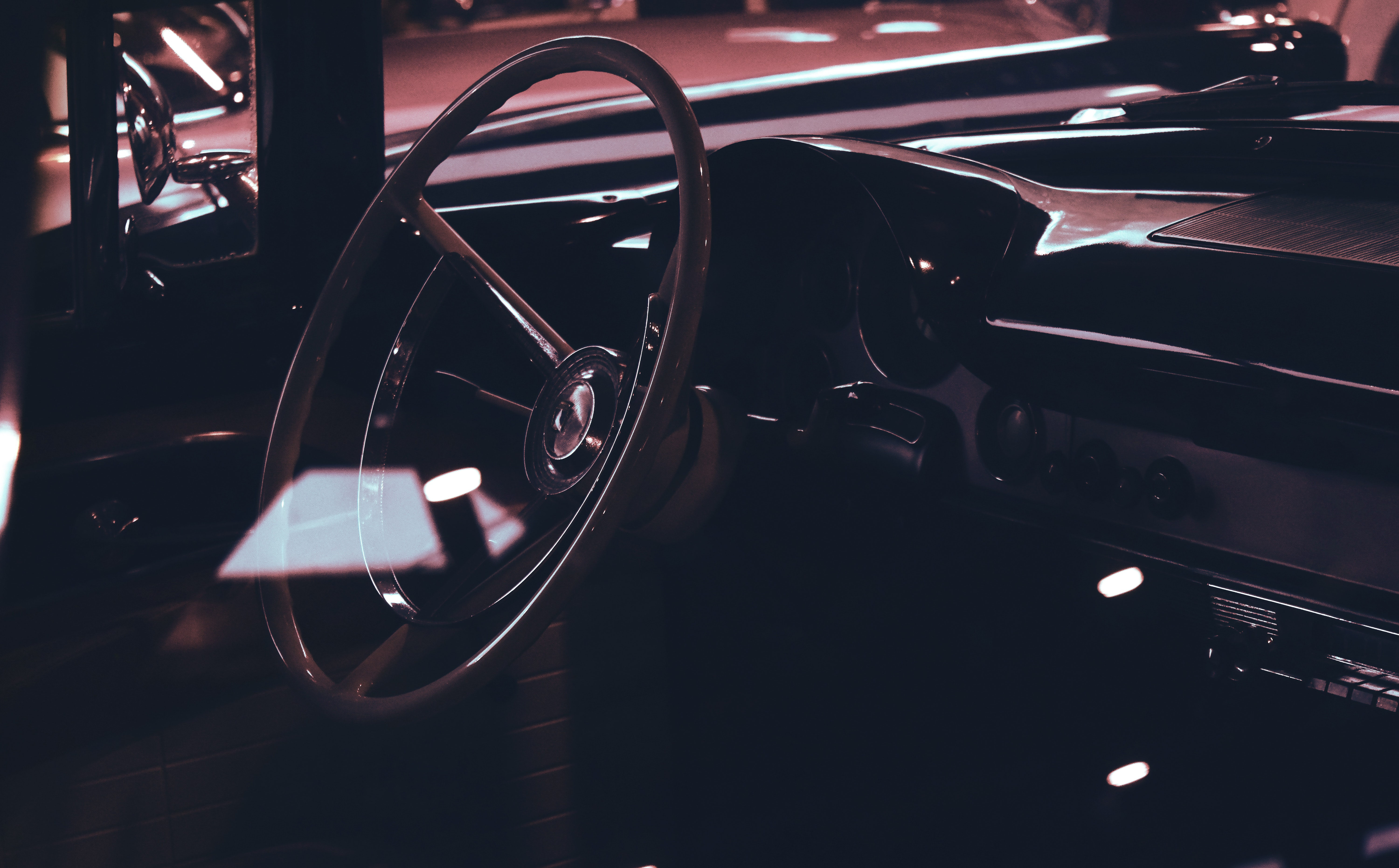 Classic car interior showing wooden steering wheel photo