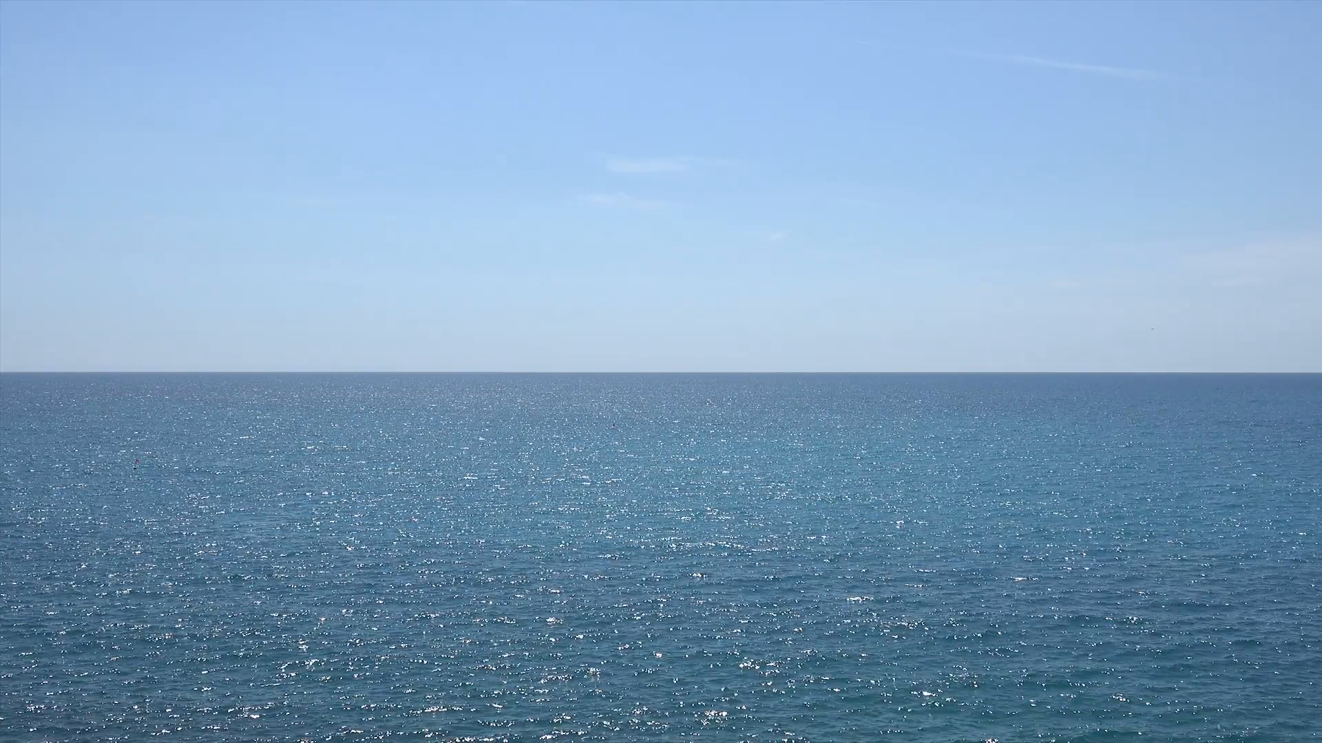Clear blue sea water sparkles in the sun with sky and horizon Stock ...