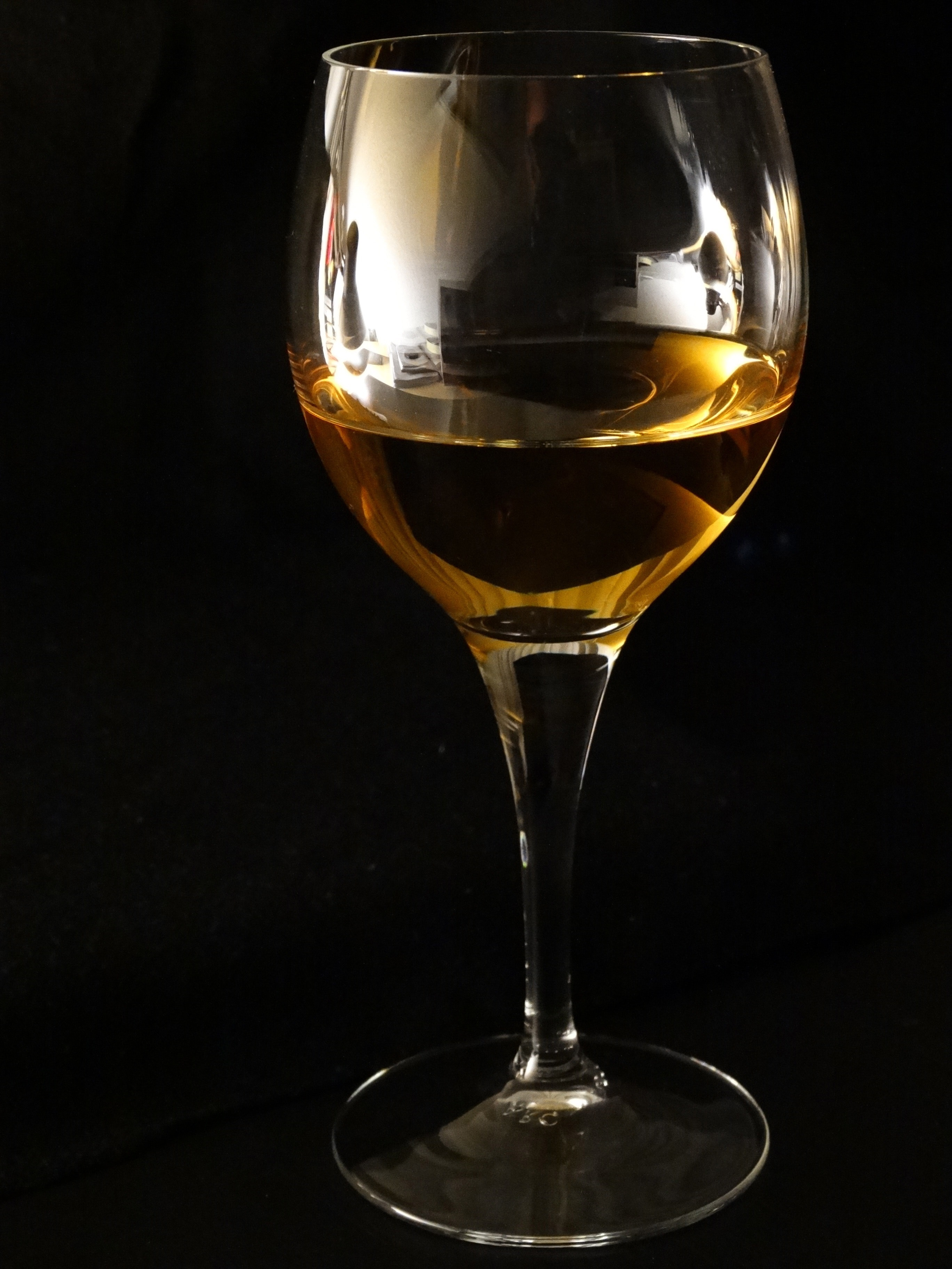 Clear long steam wine glass photo