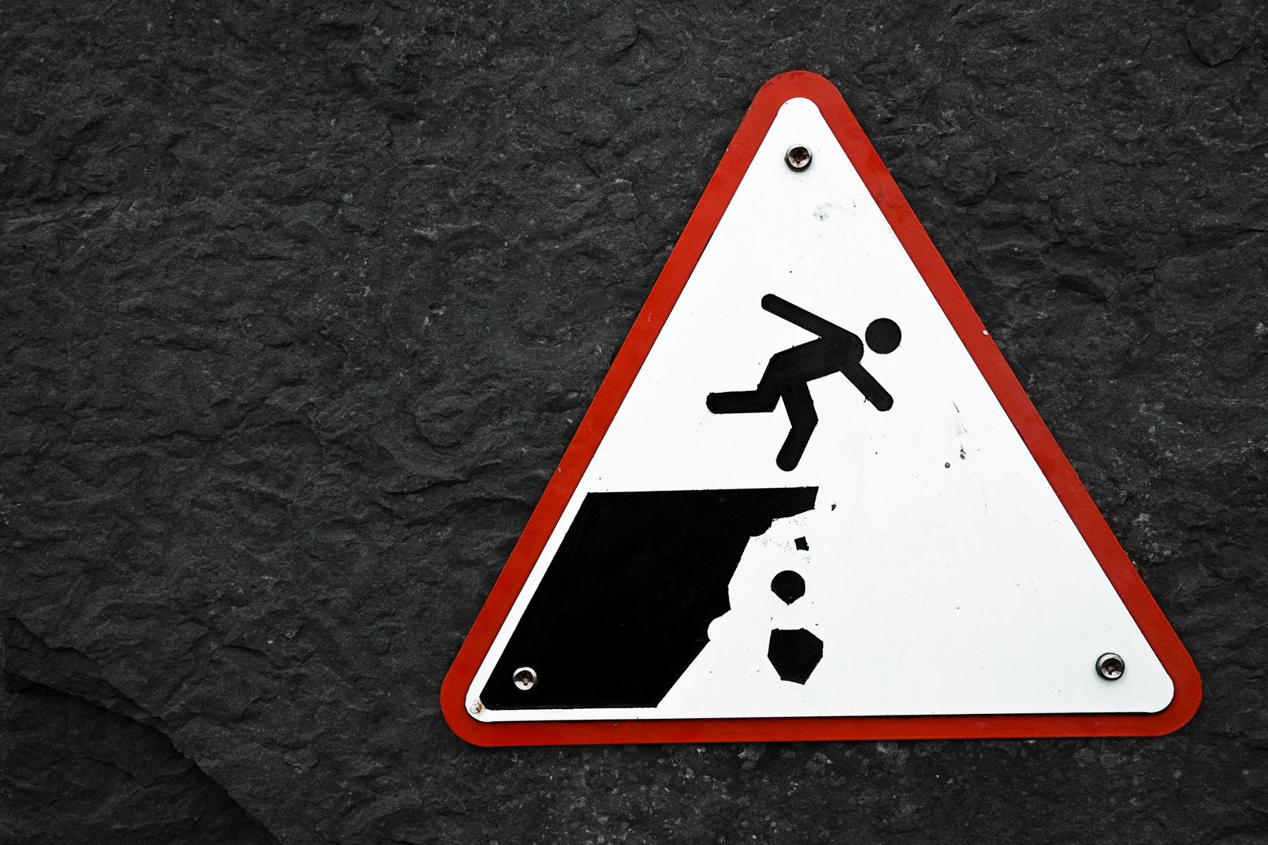 Cliff drop warning sign photo