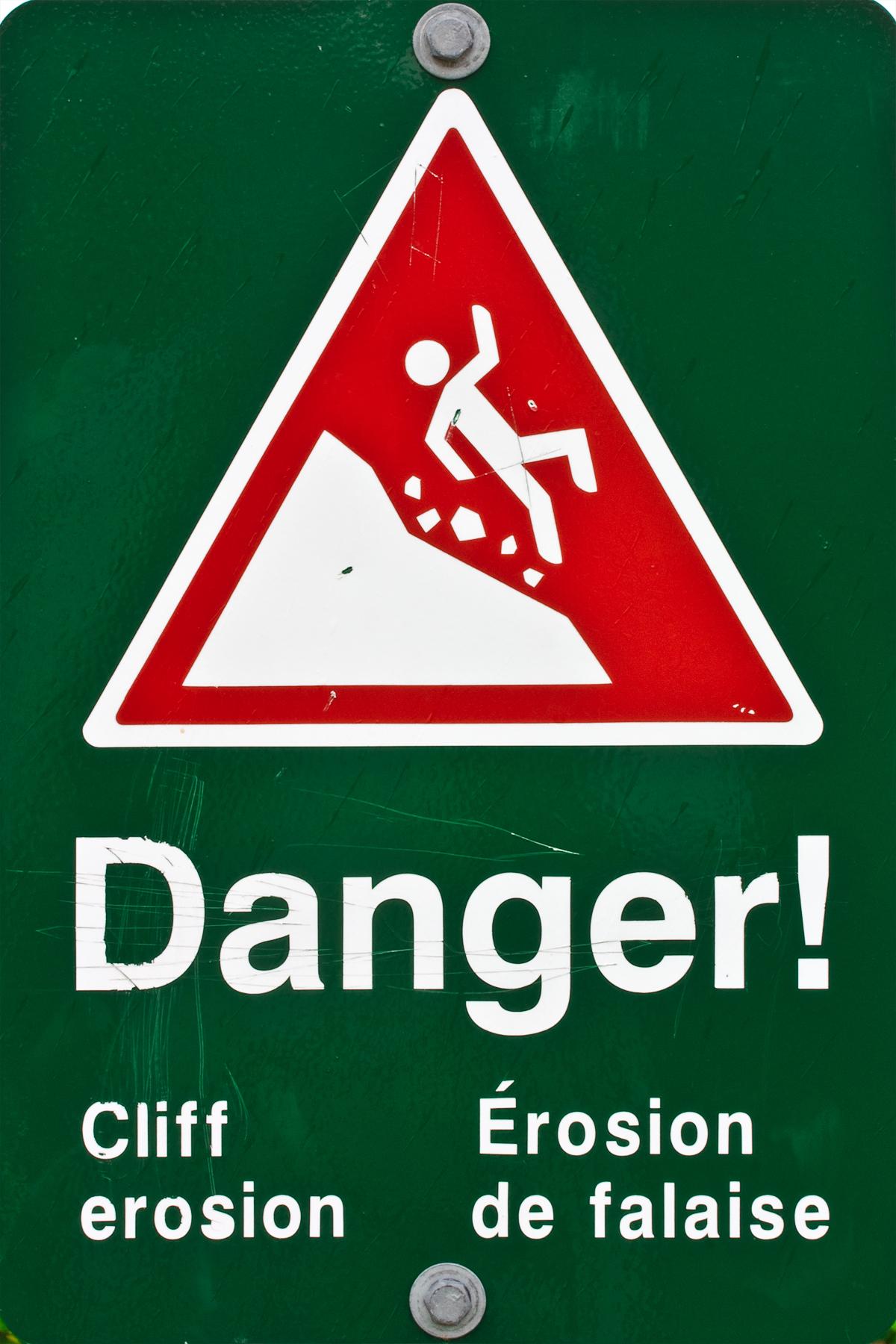 Cliff erosion warning sign photo