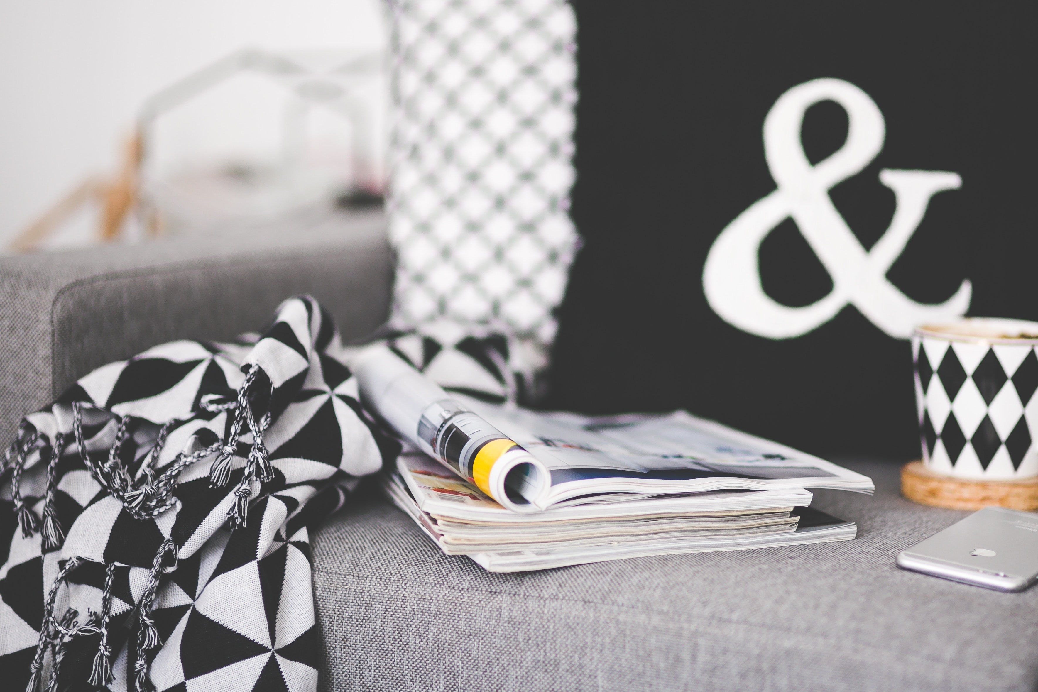 Close of magazines, mug and phone on a couch, Livingspace, Living, Live, Magazines, HQ Photo