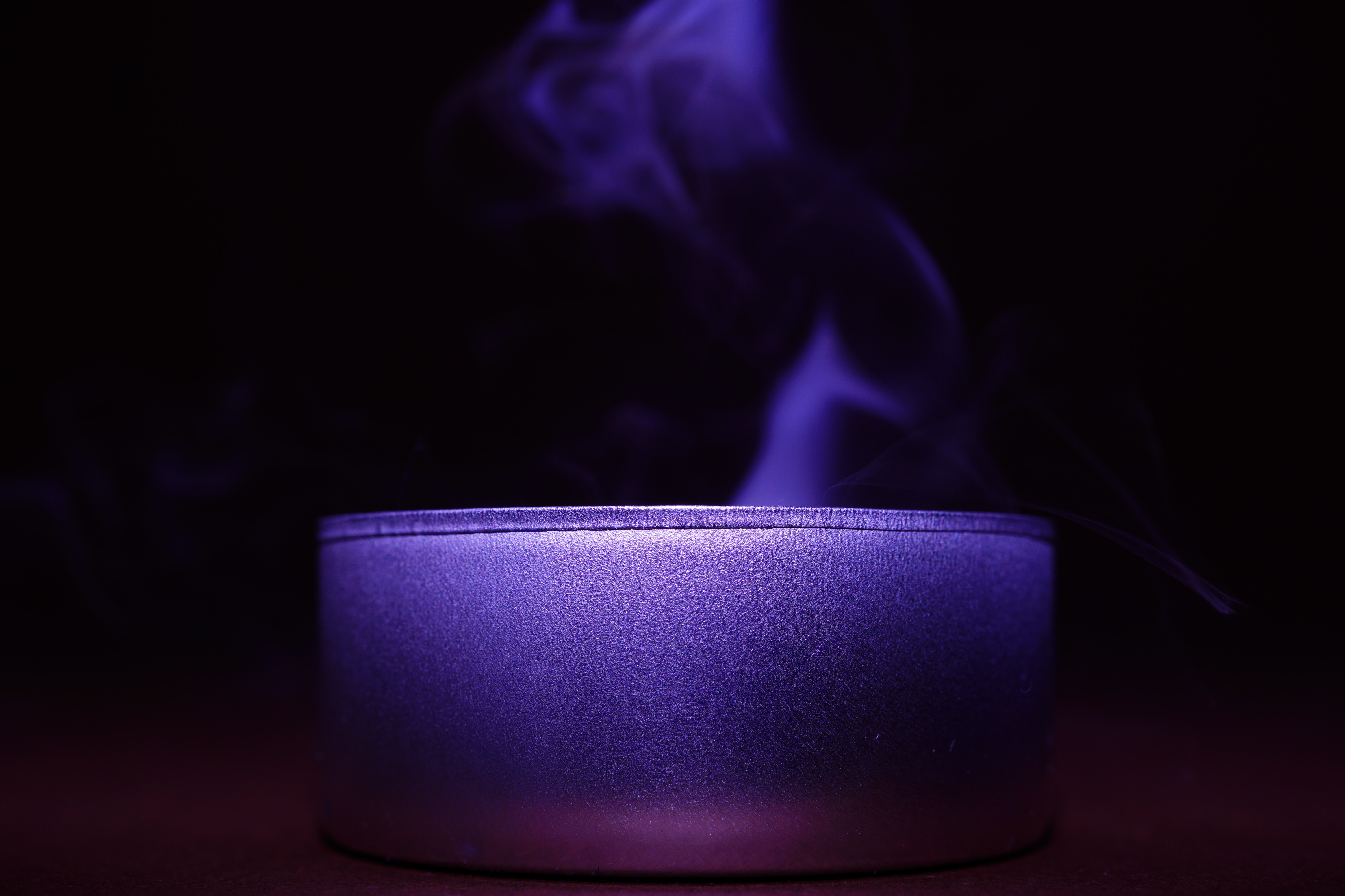 Close-up of blue candle against black background photo