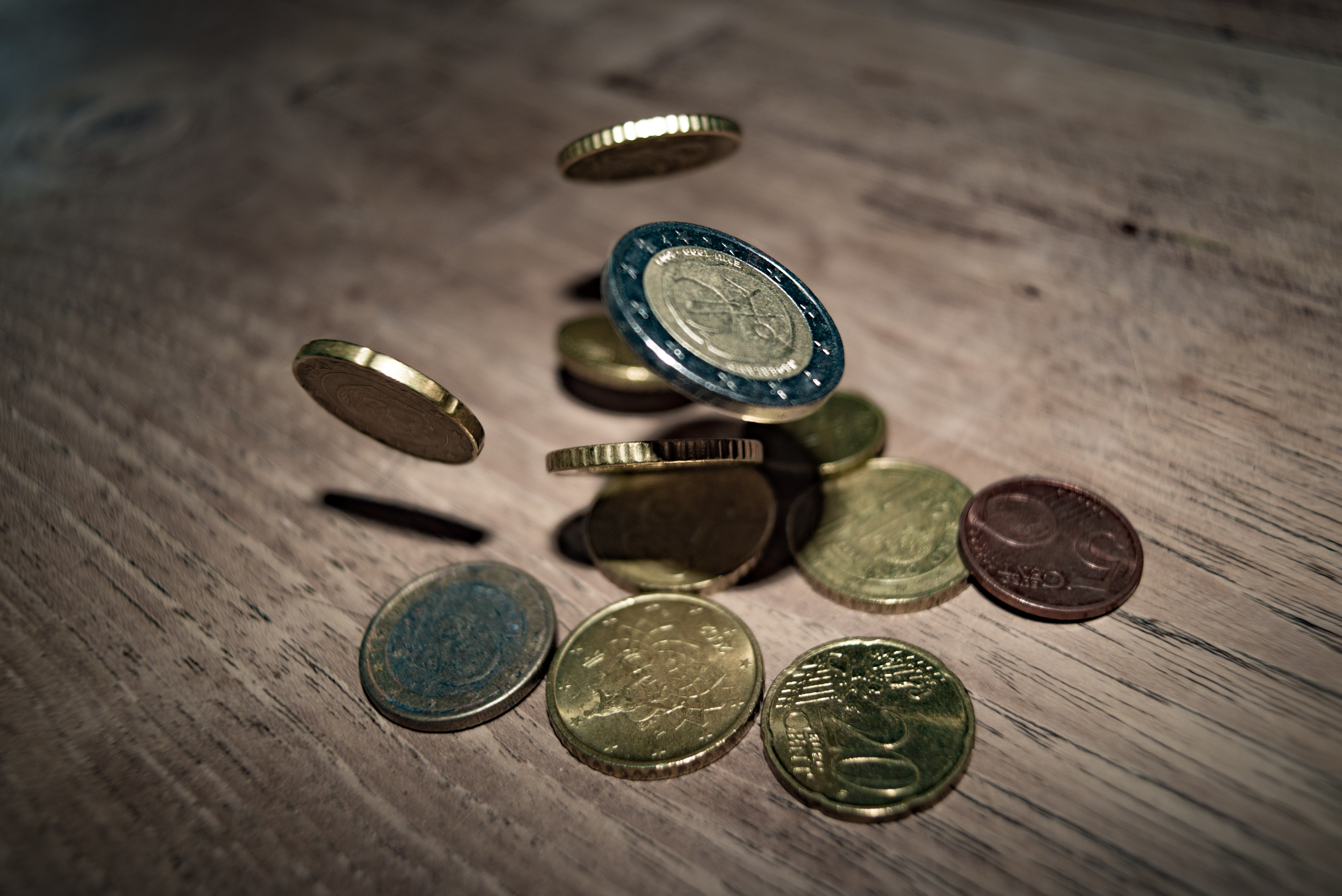 Close-up of coins on table photo