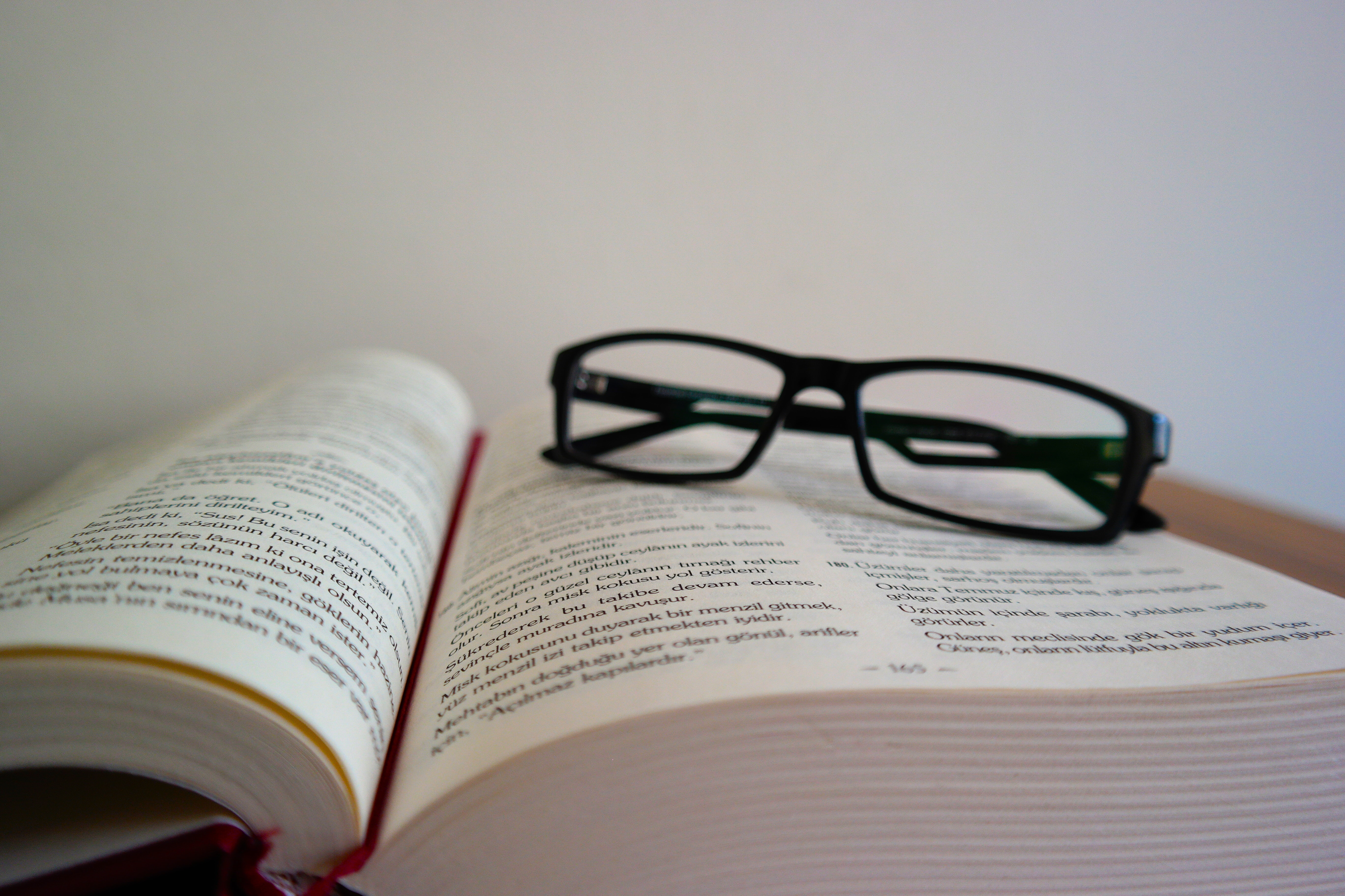 Close-up of eyeglasses on book photo