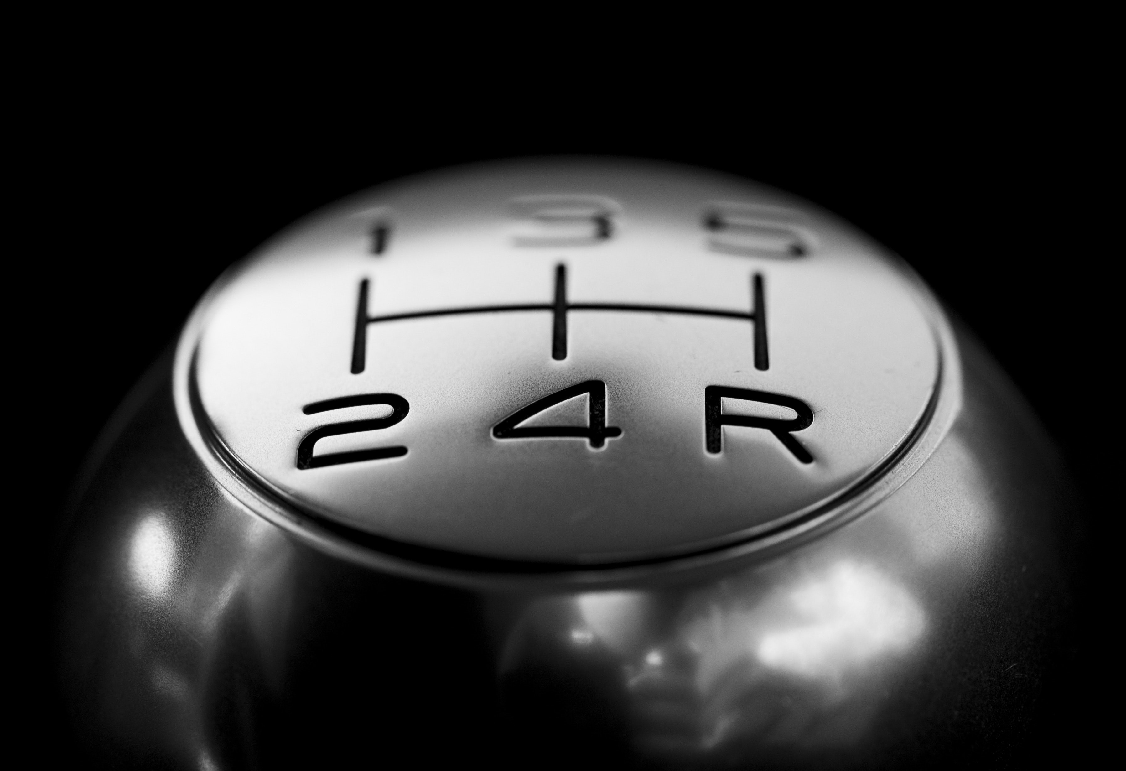 Close-up of  gear shift over black background photo