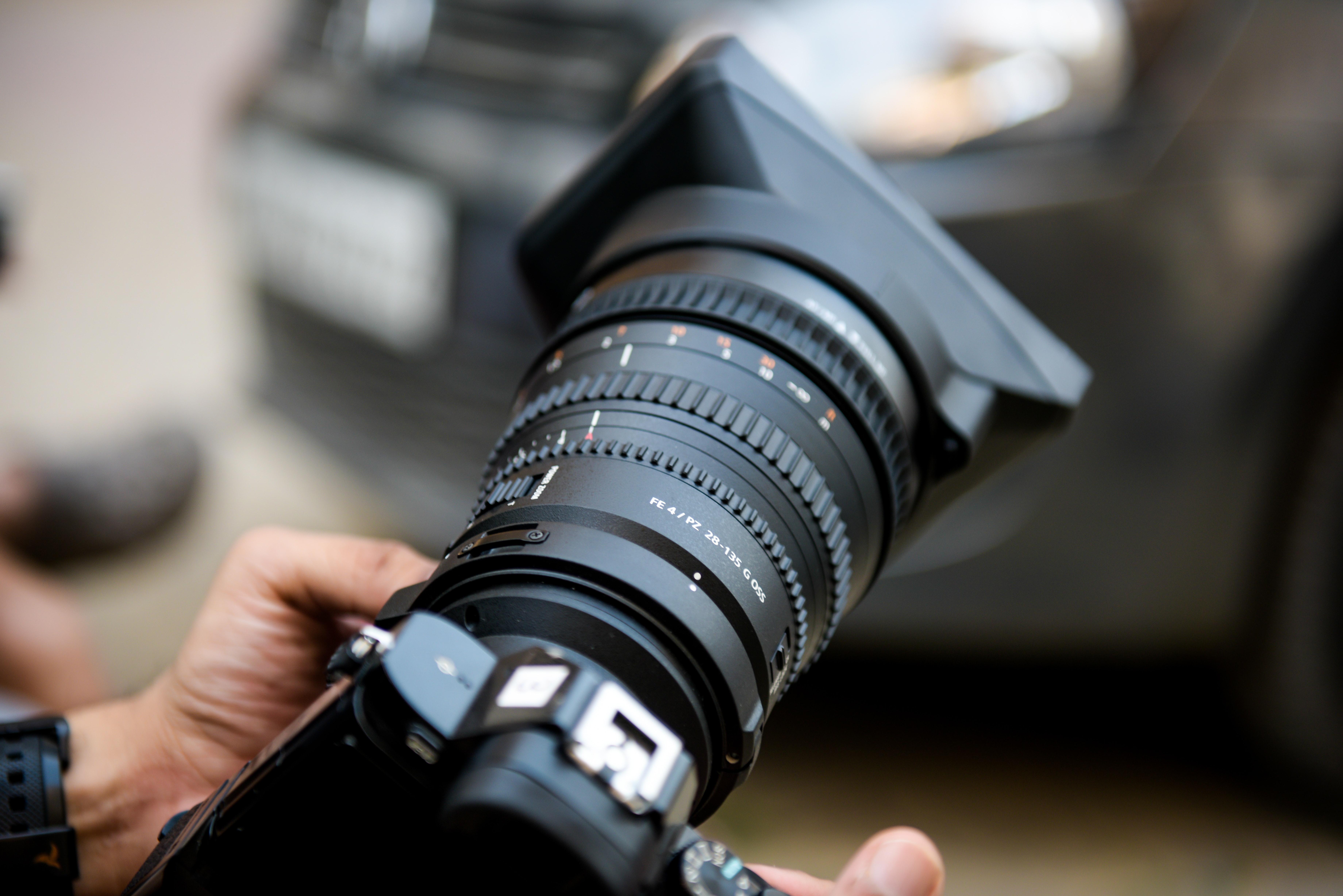 Close-up of person using camera photo