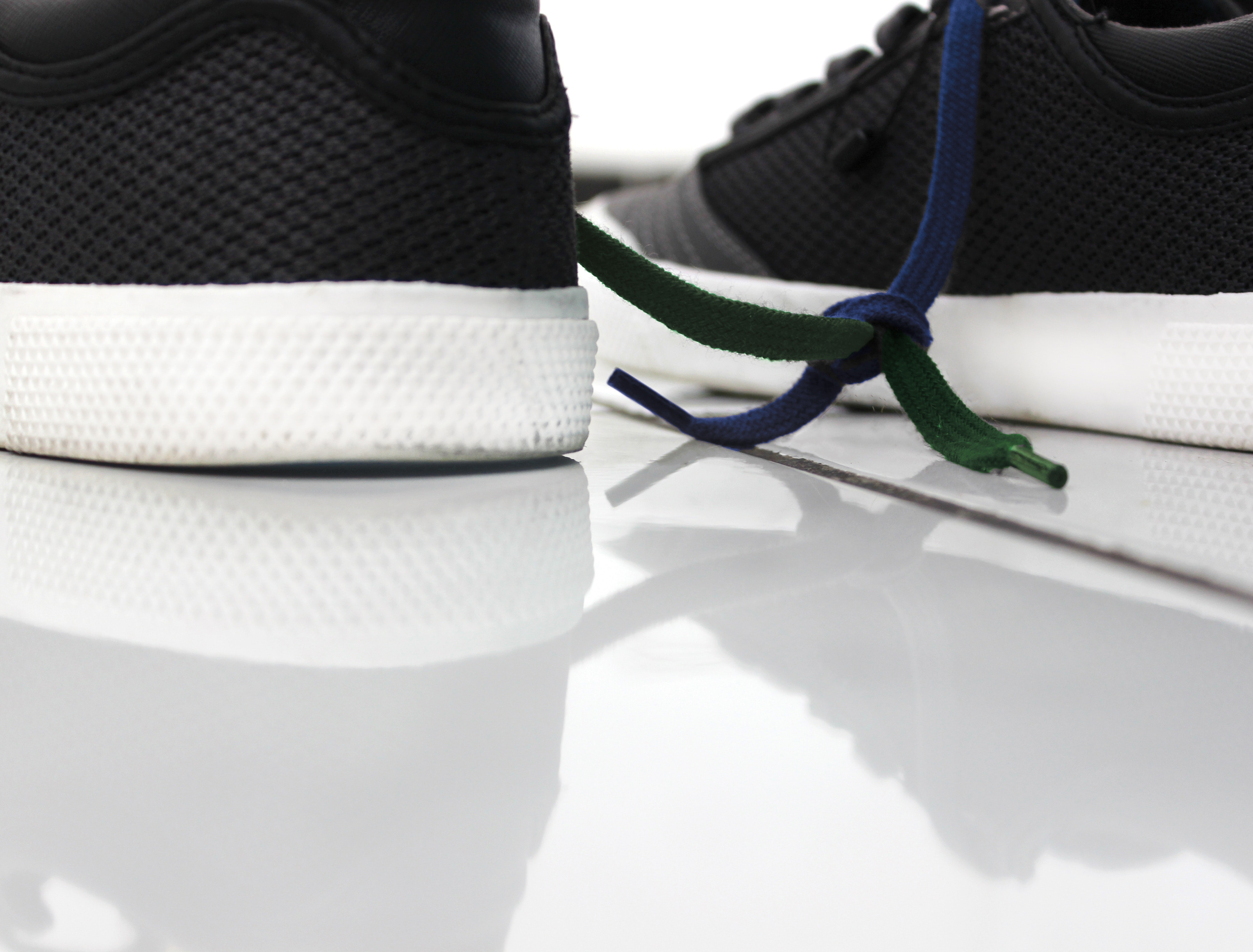 Close-up of shoes against white background photo