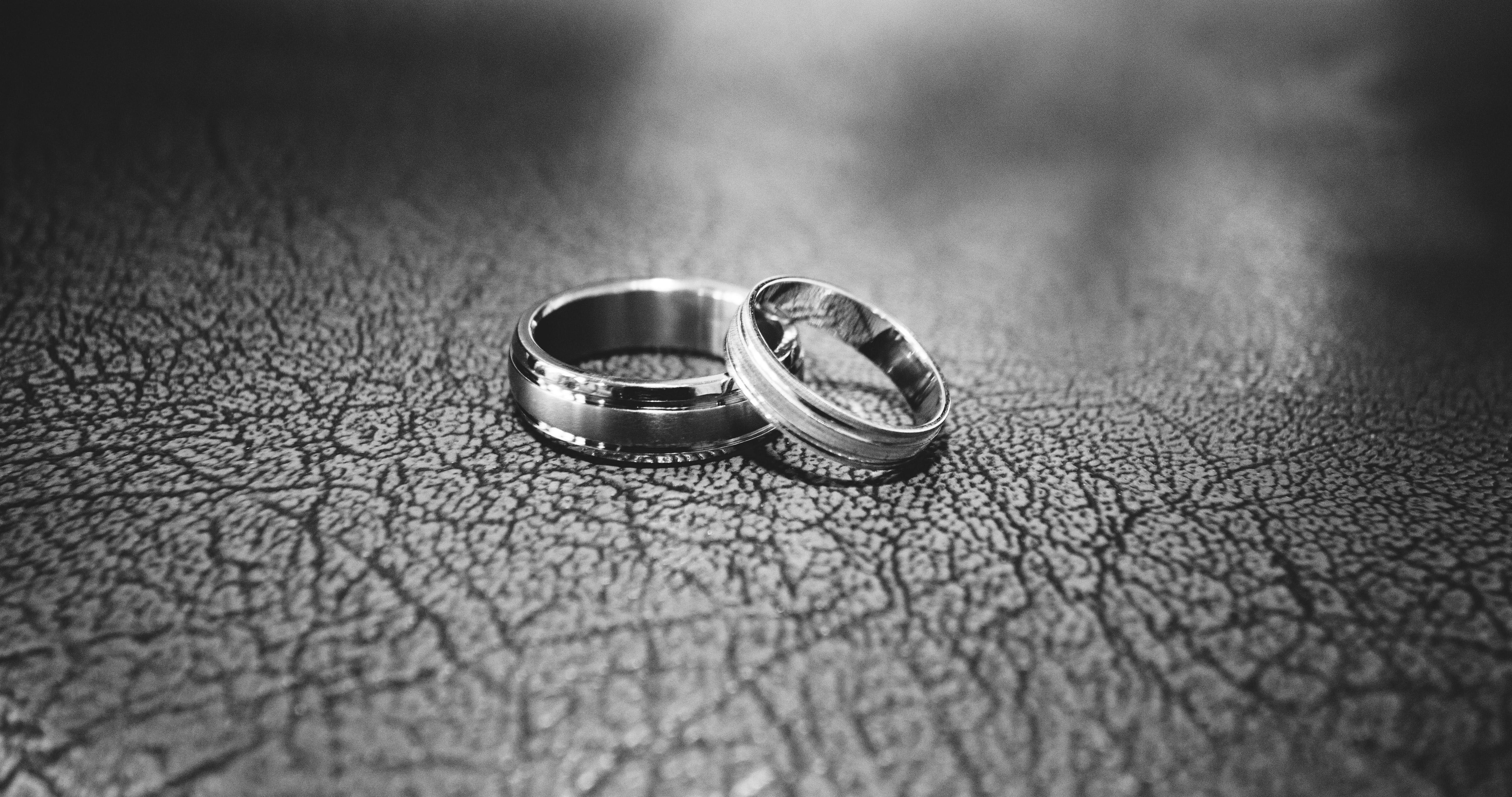 Close-up of wedding rings on floor photo
