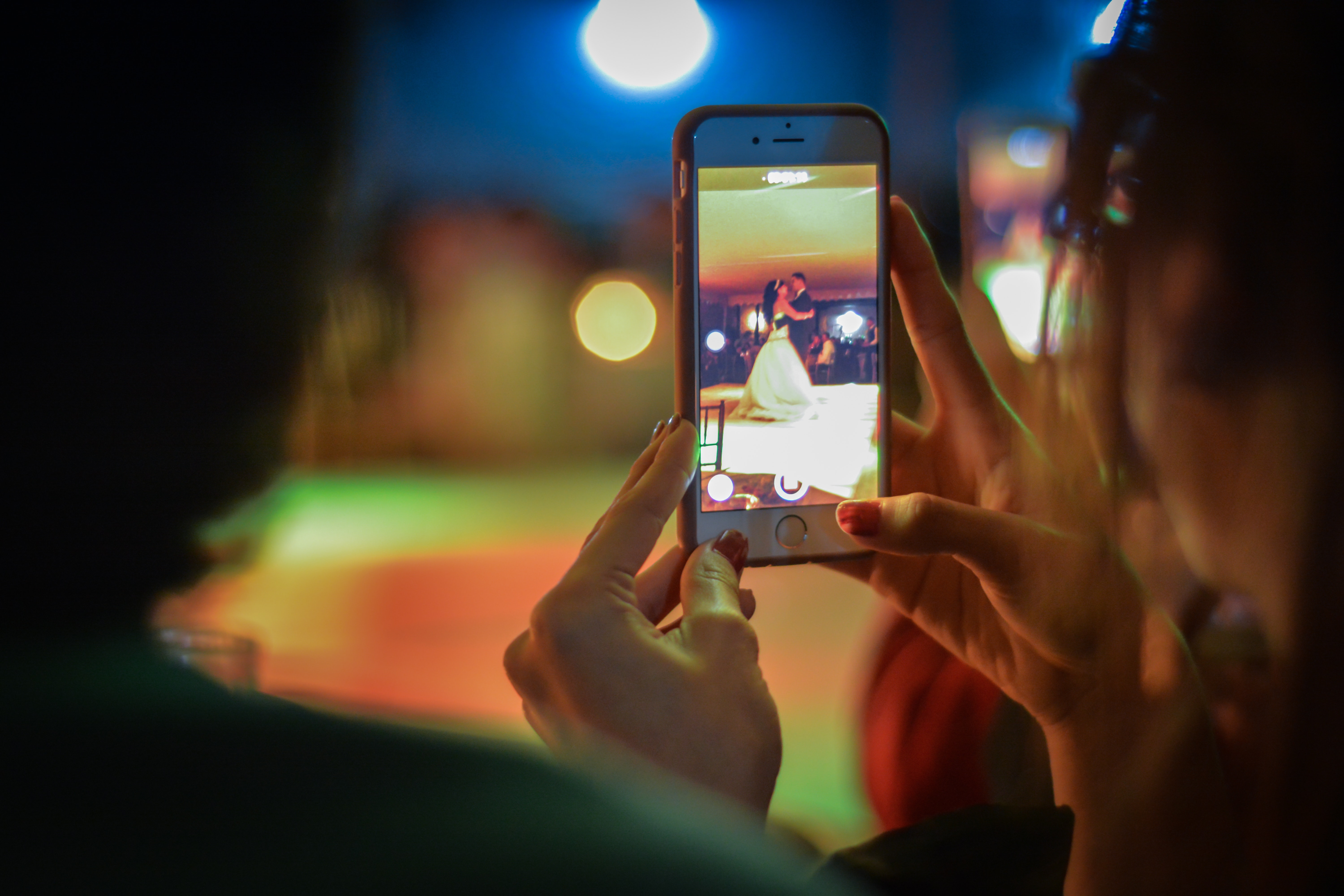 Close-up of woman using mobile phone at night photo
