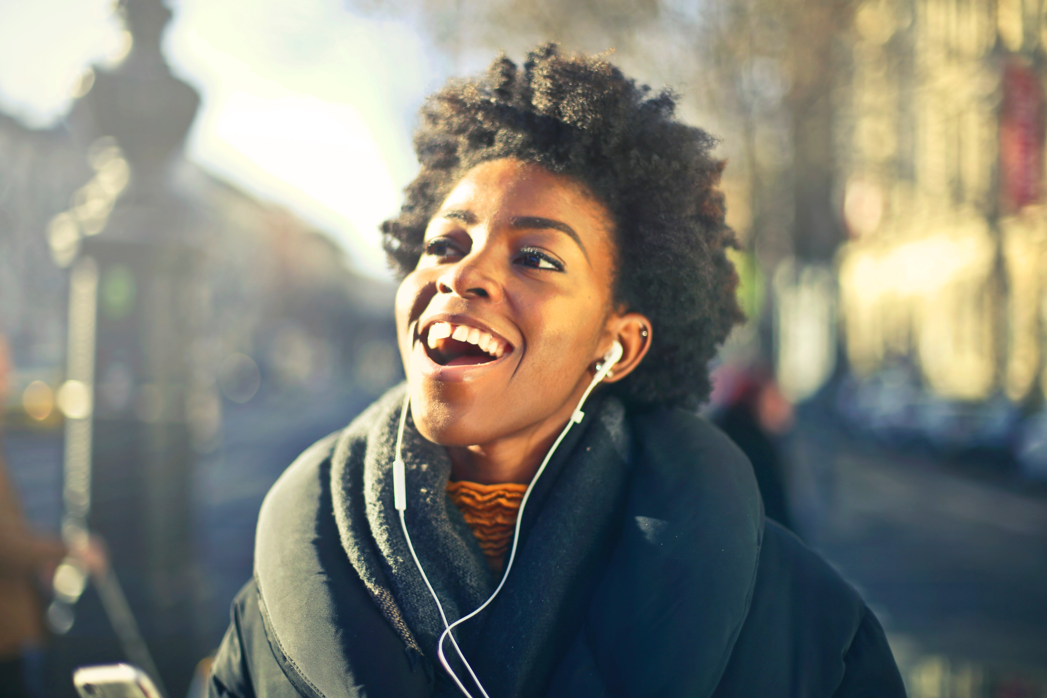 Close-up photo of a woman listening to music