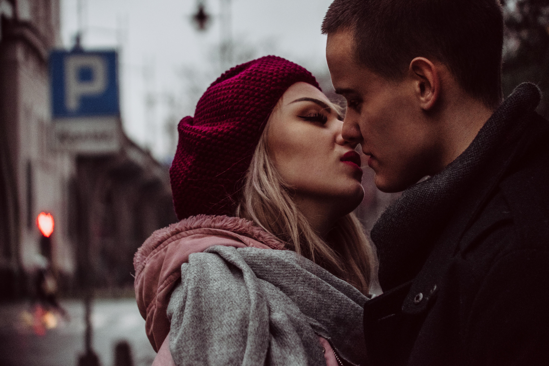 Free Photo Close Up Photograph Of Woman Kissing Man Street Scarf Romance Portrait