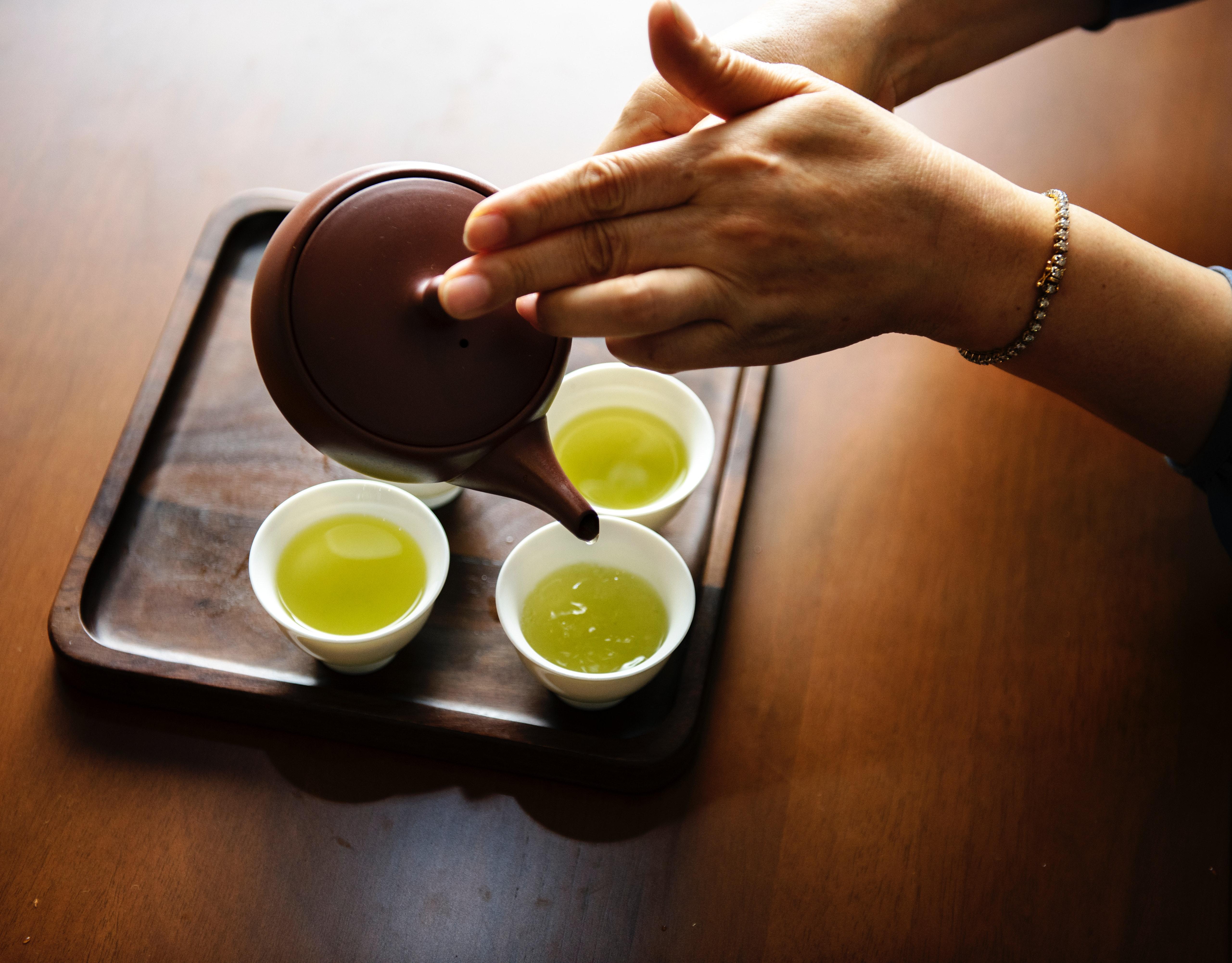 Close-up photography of teapot pouring tea