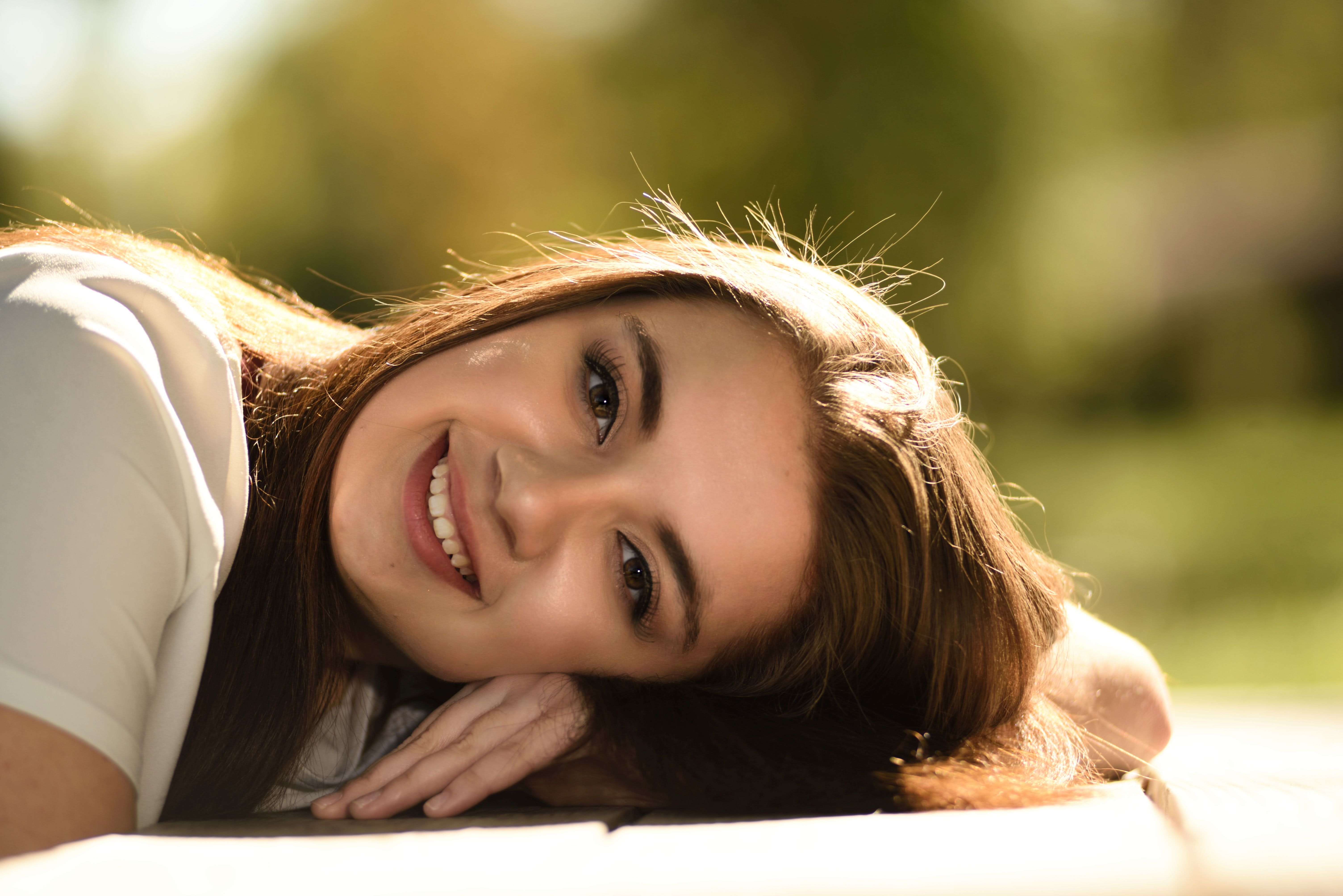 Close Up Photography of Woman Laying on Table, Hand, Young, Woman, Smiling, HQ Photo
