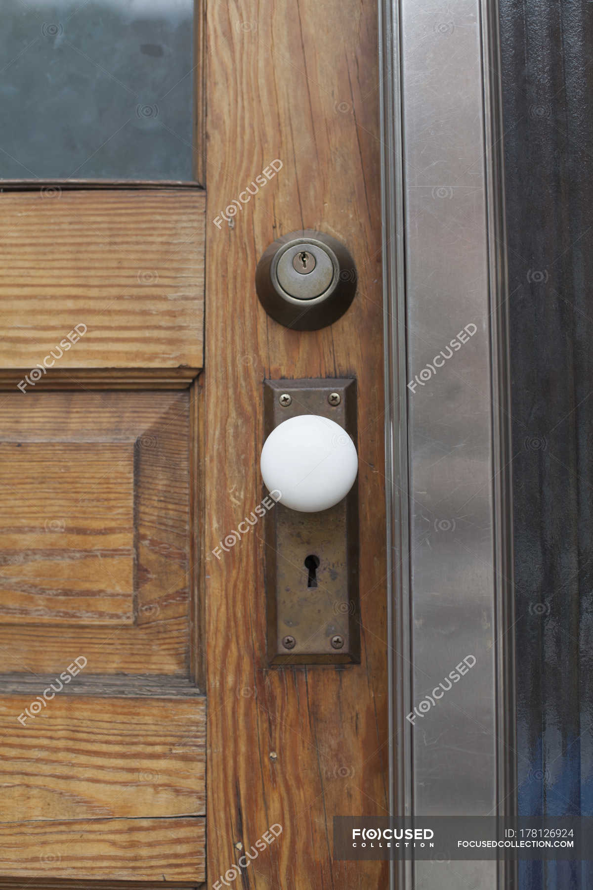 Close up view of closed wooden door — Stock Photo | #178126924