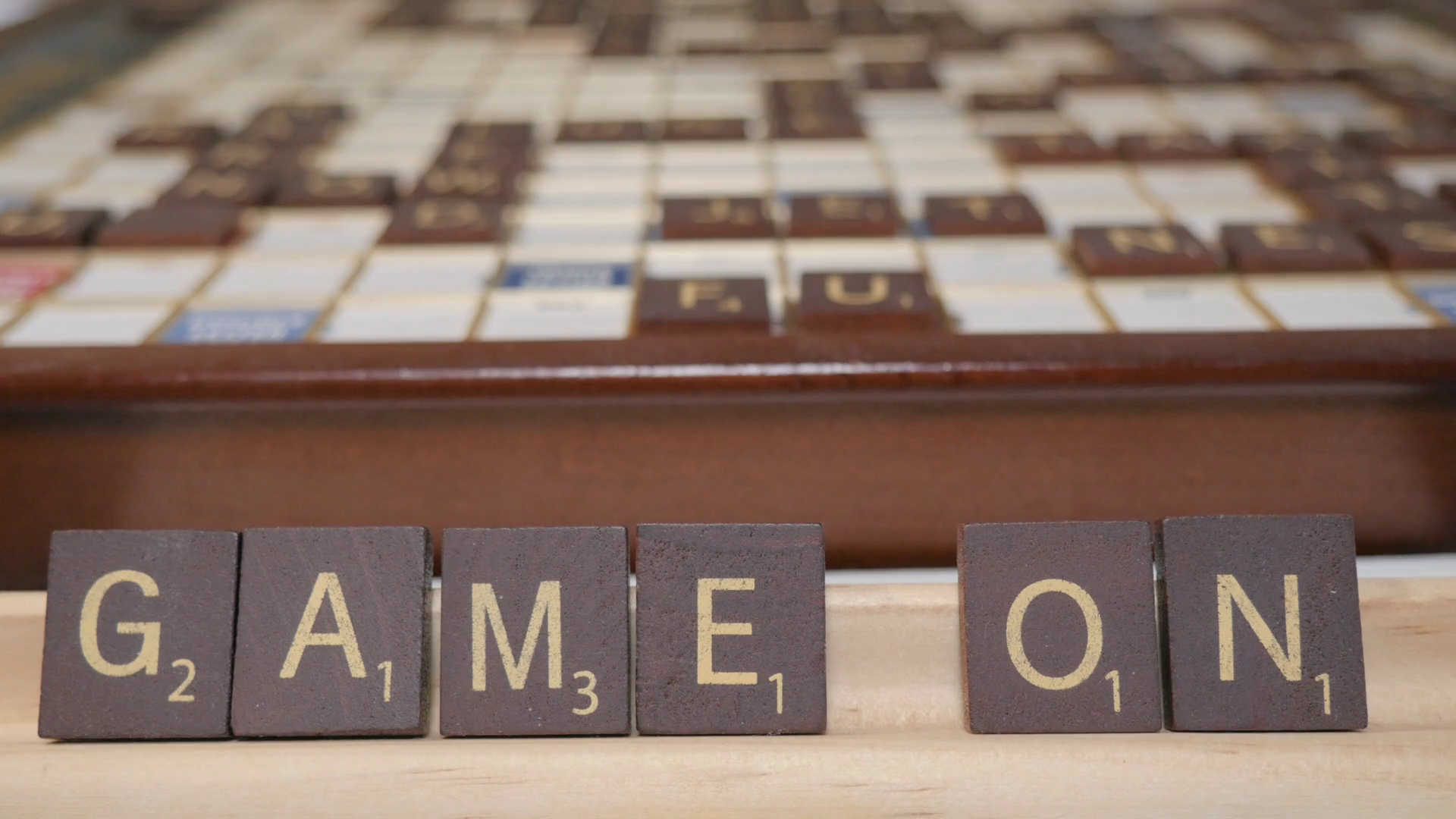 Closeup of tiles spelling the phrase Game On in 4k. The classic ...