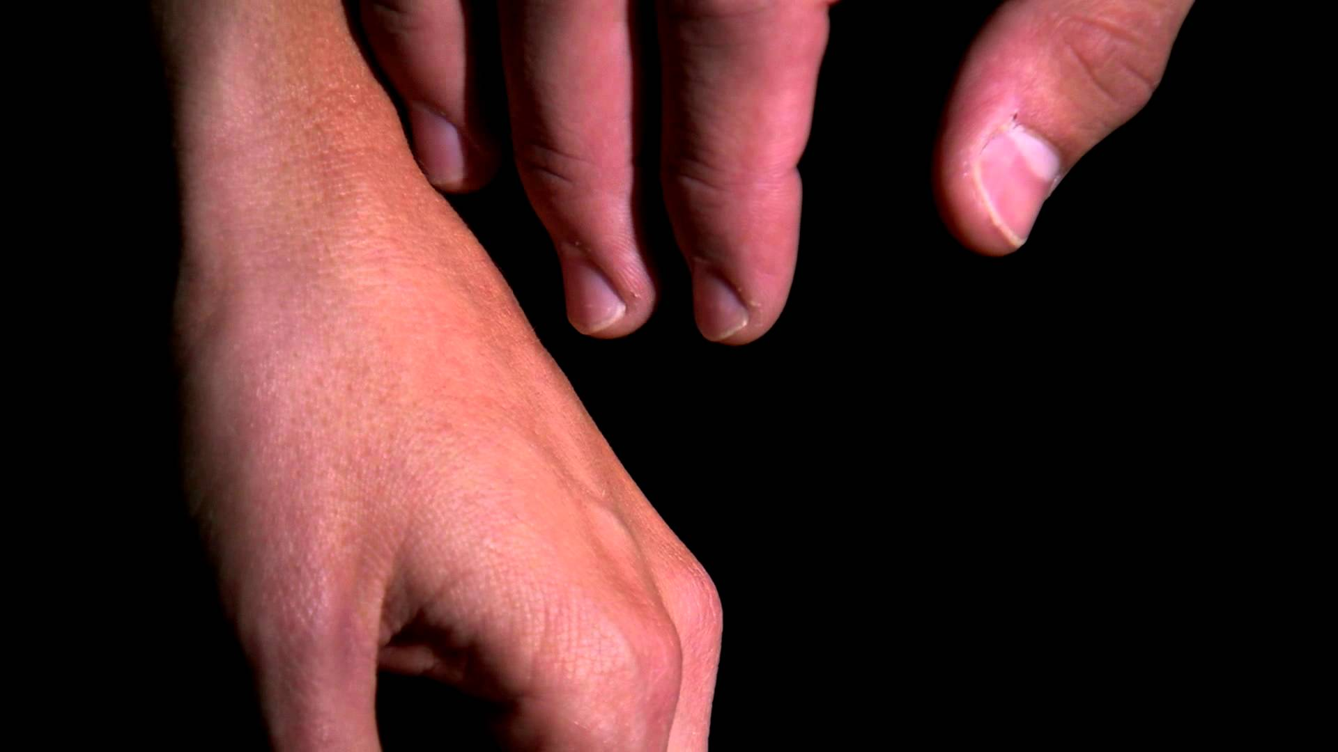 Close up of hands moving slowly to hold each other. - YouTube