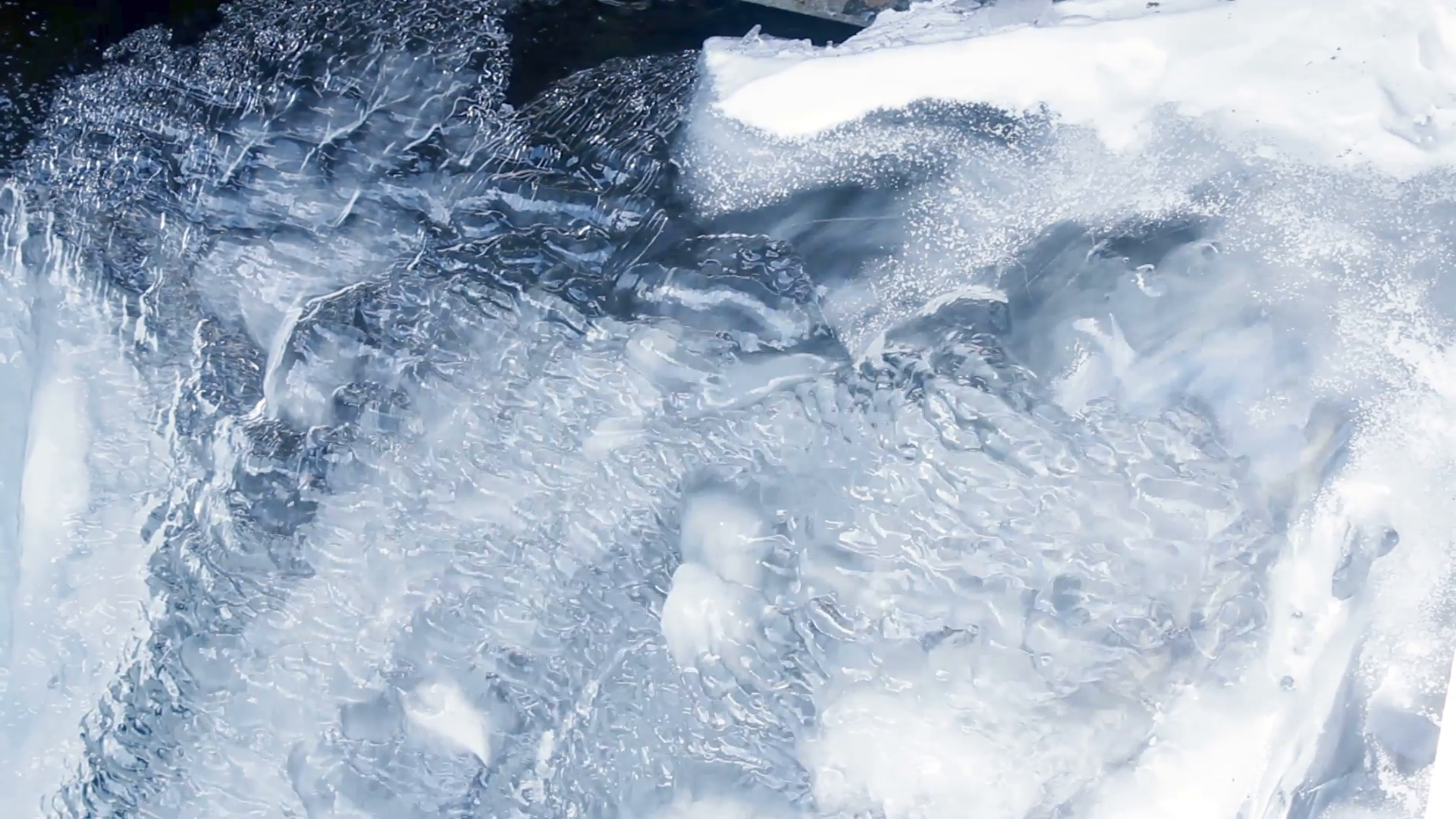 Water flowing under transparent ice surface. Ice background. Ice ...