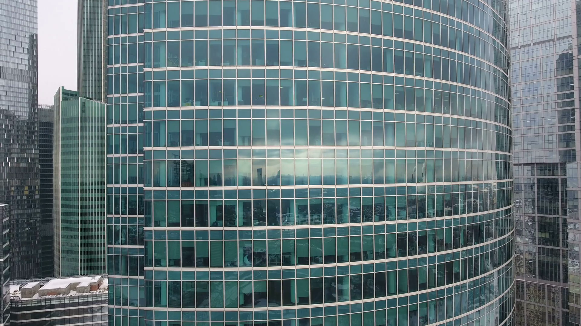 Skyscrapers. Office windows with city reflected in it. Nobody. Close ...