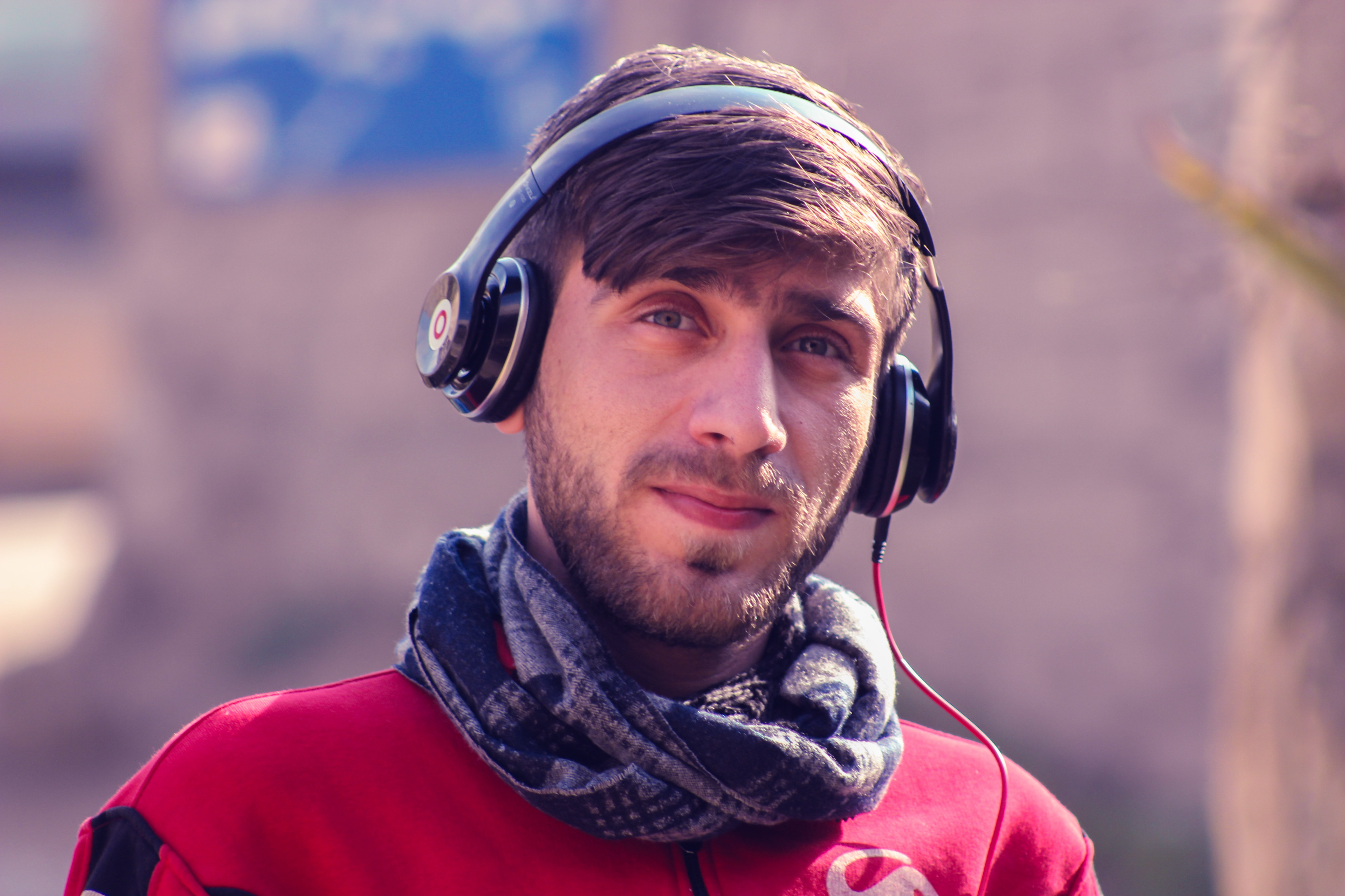 Free Photo Closeup Photo Of A Man Wearing Red Top Gray Scarf And Black Beats By Dr Dre Headphones Adult Headphones Leisure Free Download Jooinn