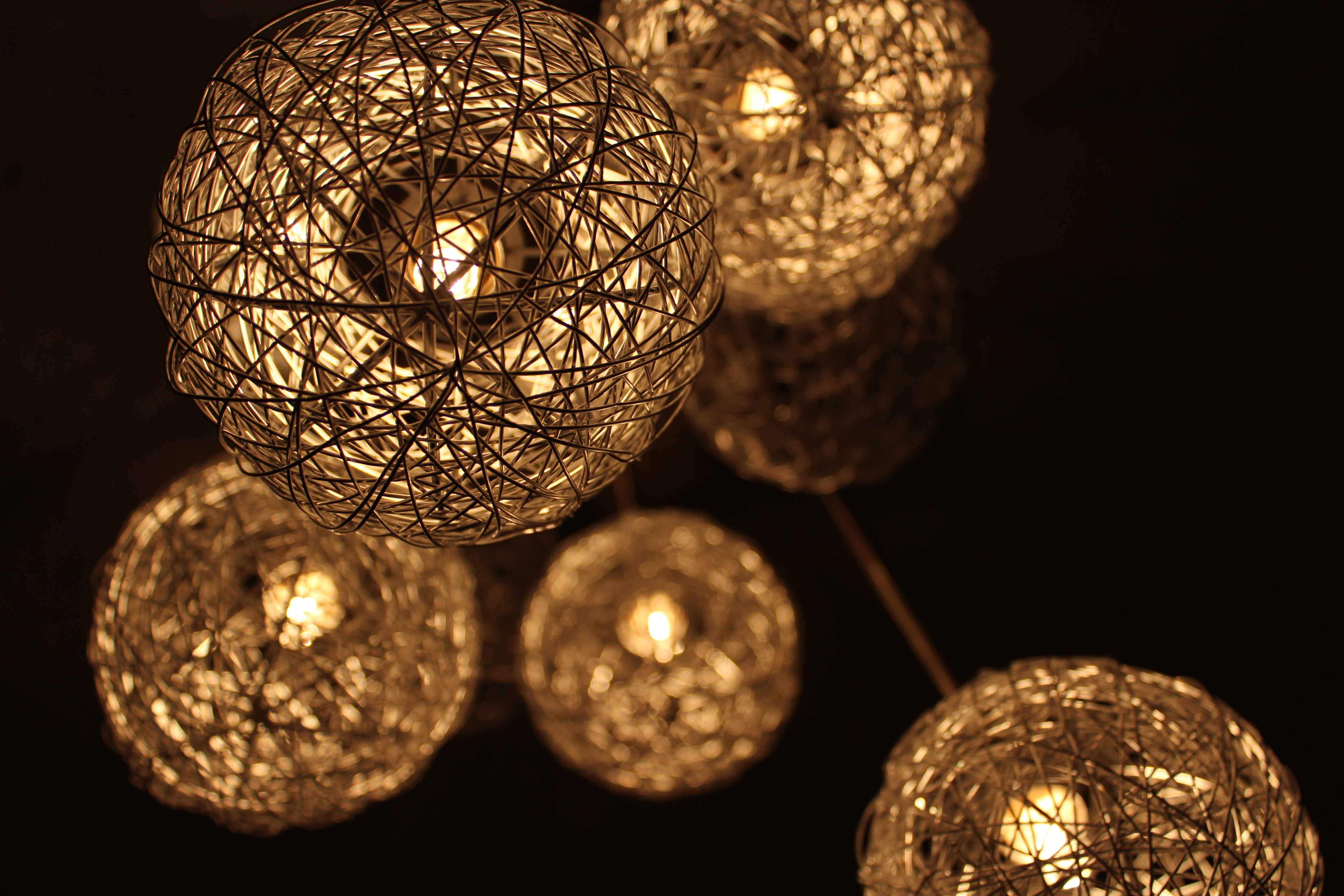 Closeup photo of brown round twig pendant lamps