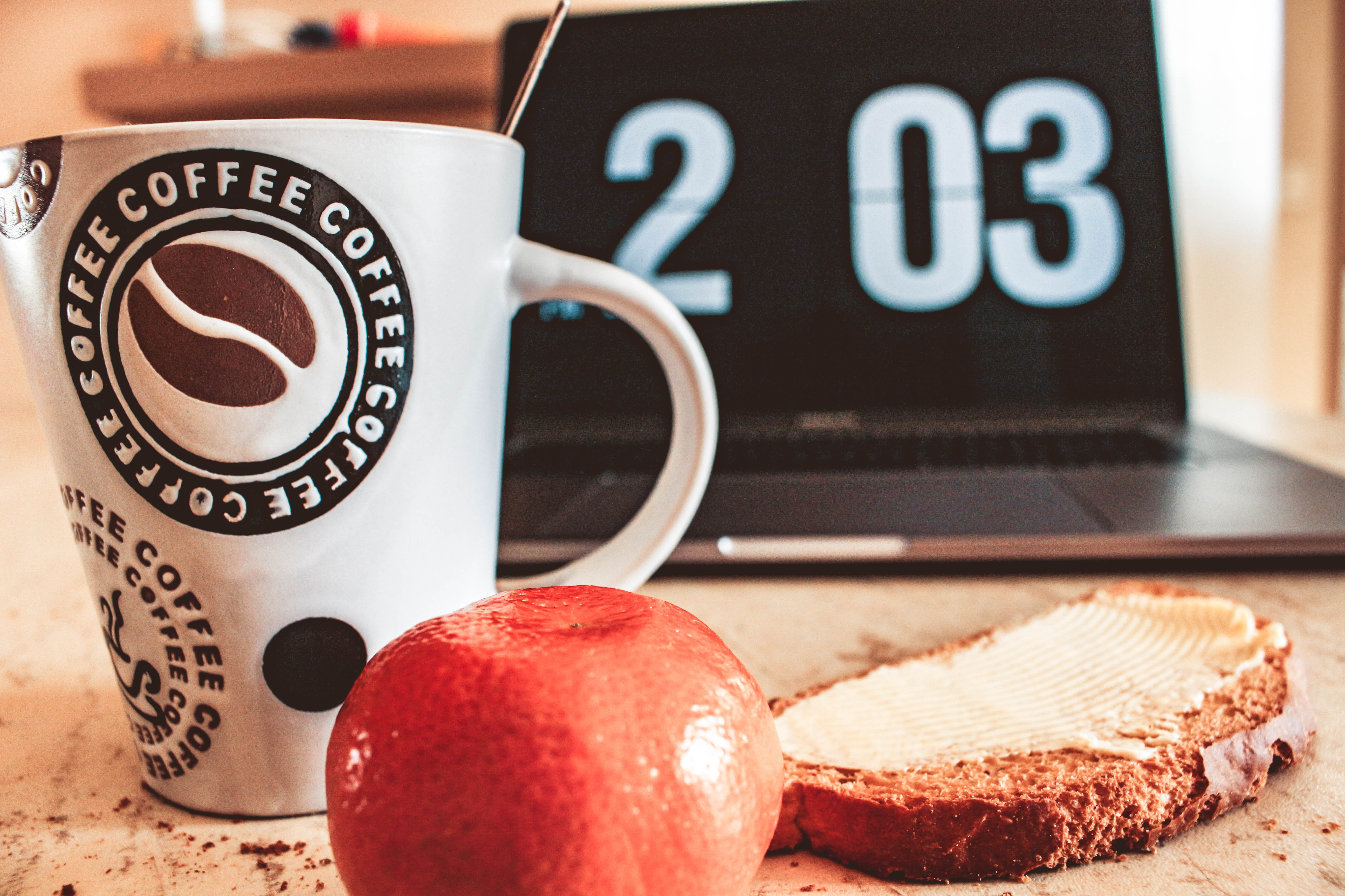 Closeup Photo of White and Black Printed Ceramic Mug Beside Pastry, Bread, Fruit, Time, Table, HQ Photo