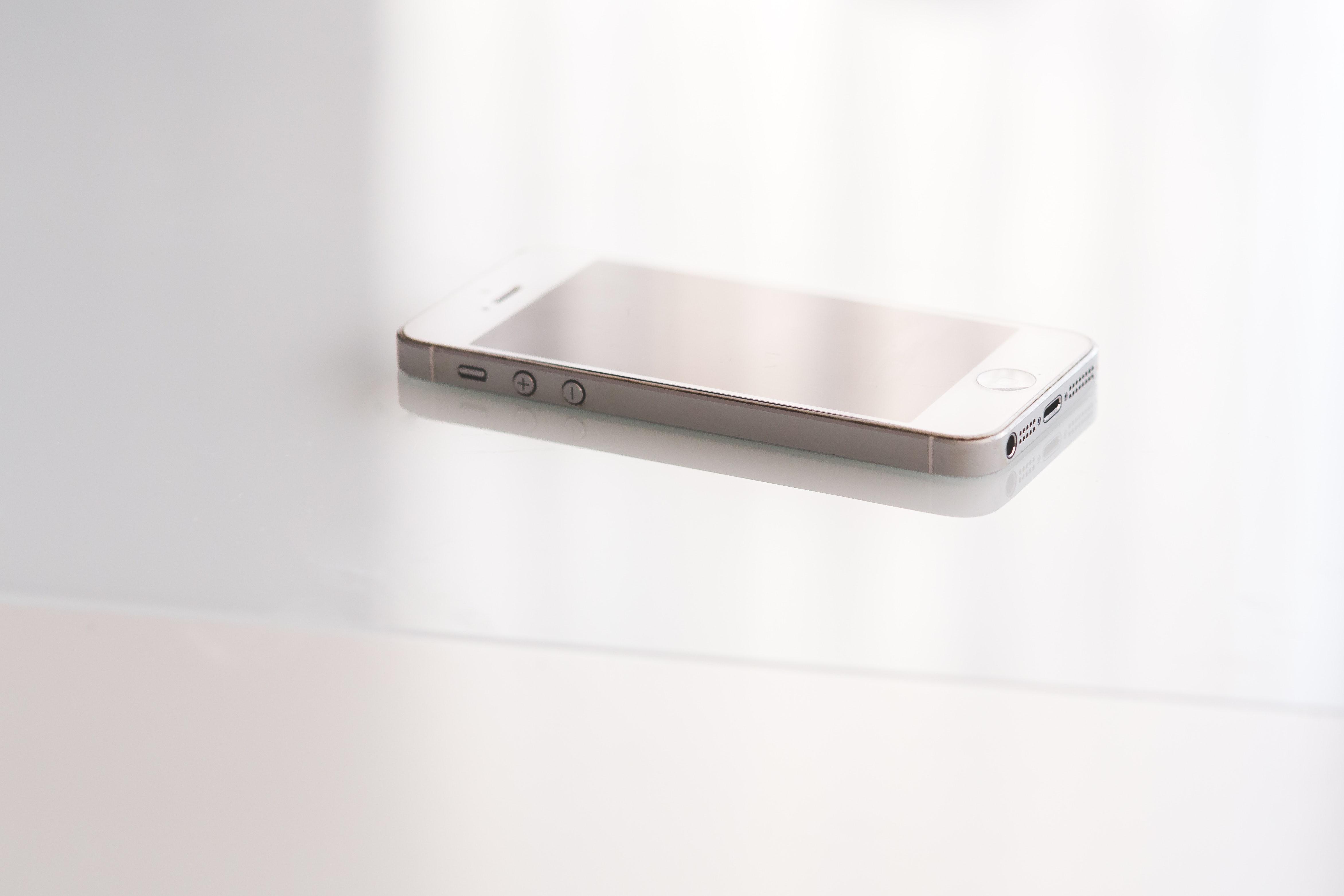 Closeup view of white smart phone. connectors details. photo