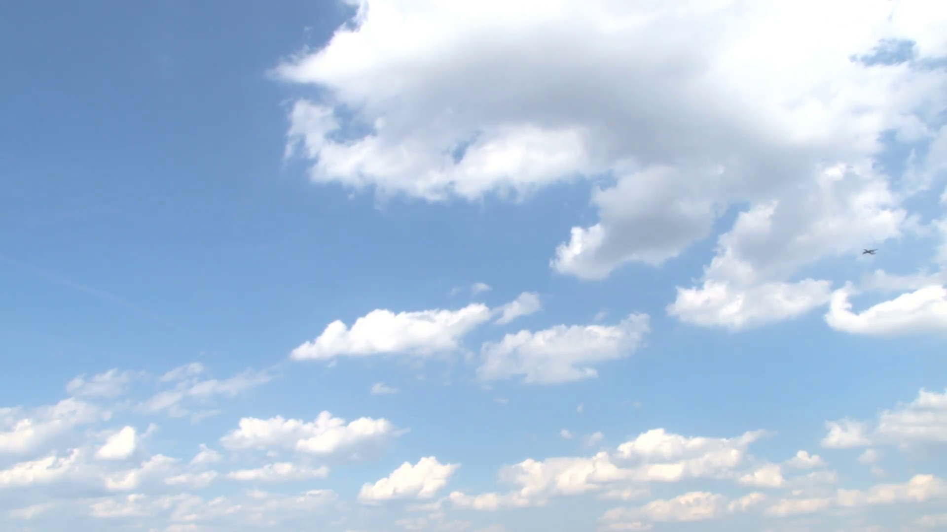 Plane Flying Across Partly Cloudy Sky Stock Video Footage - VideoBlocks