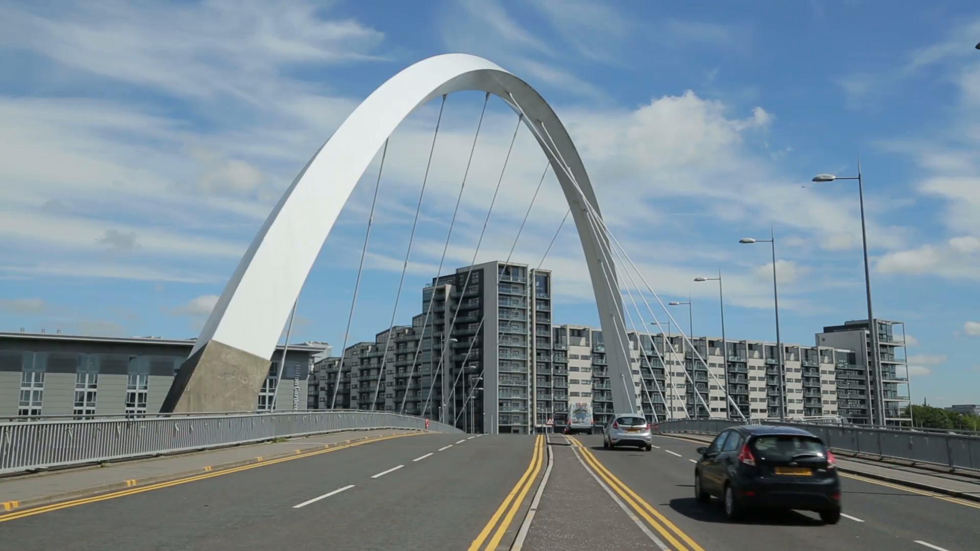 traffic crosses road over the clyde arc bridge, glasgow, scotland ...
