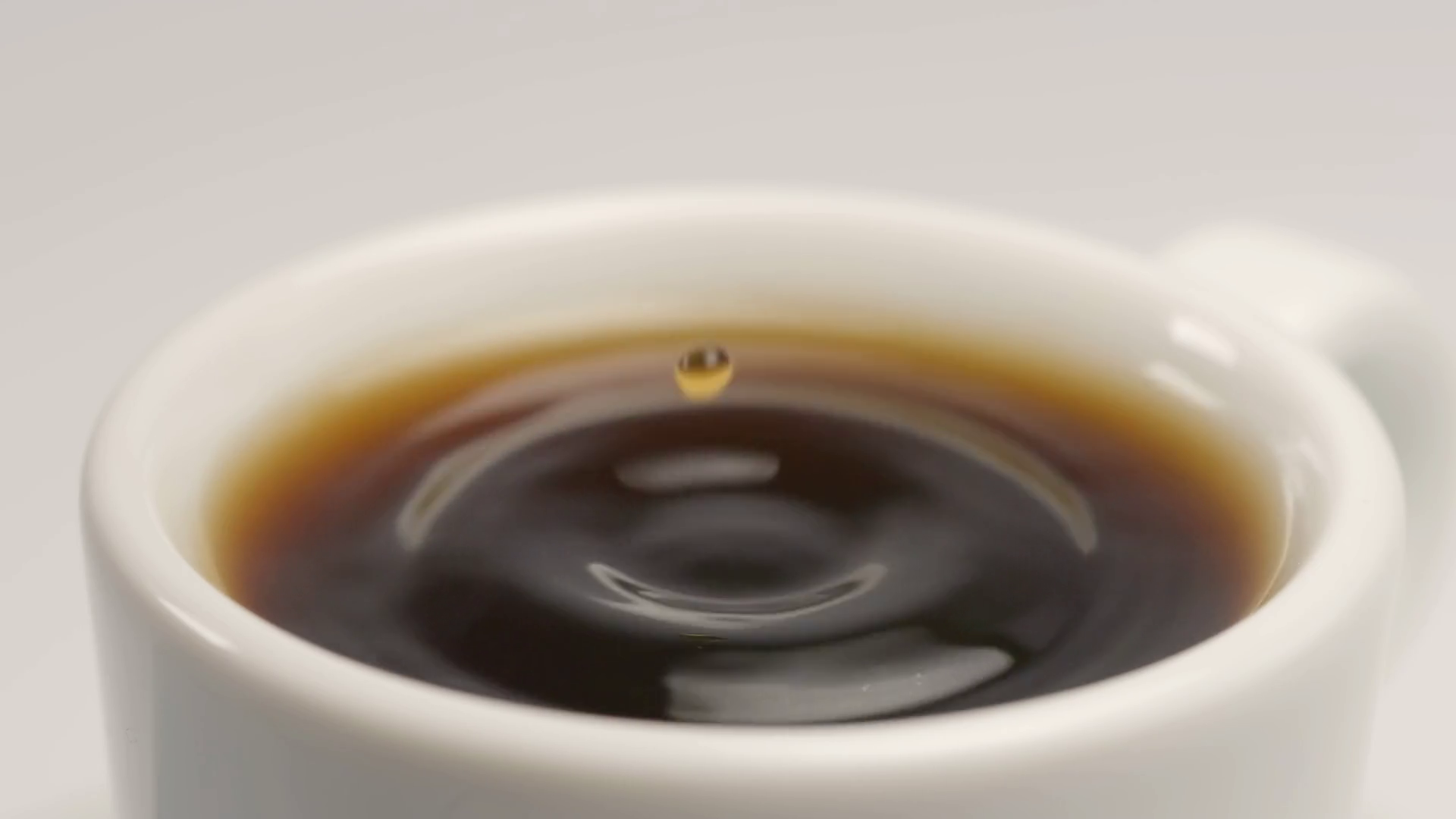 SLOW MOTION: Coffee drop falls to a white cup Stock Video Footage ...