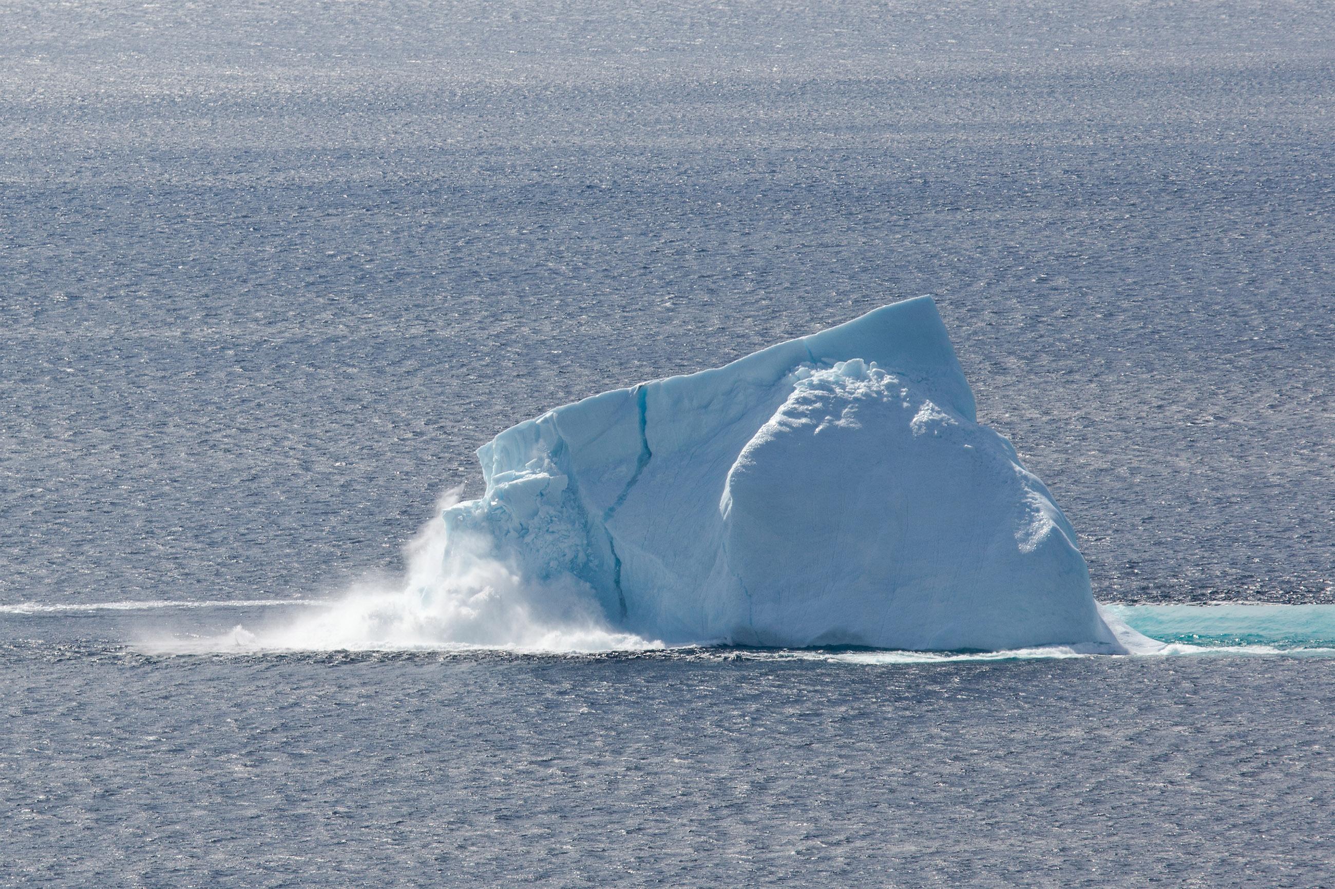 Collapsing iceberg photo