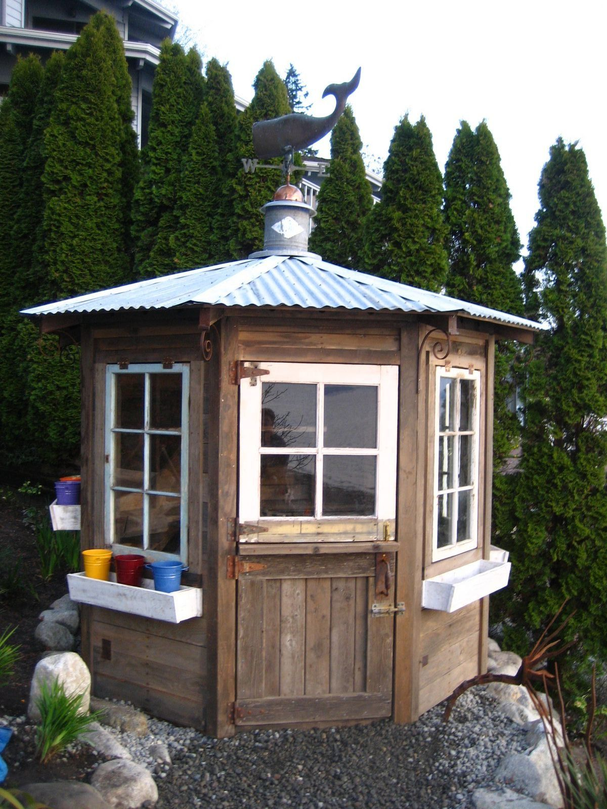 A Dutch door, whale weathervane and colorful pots in the window ...