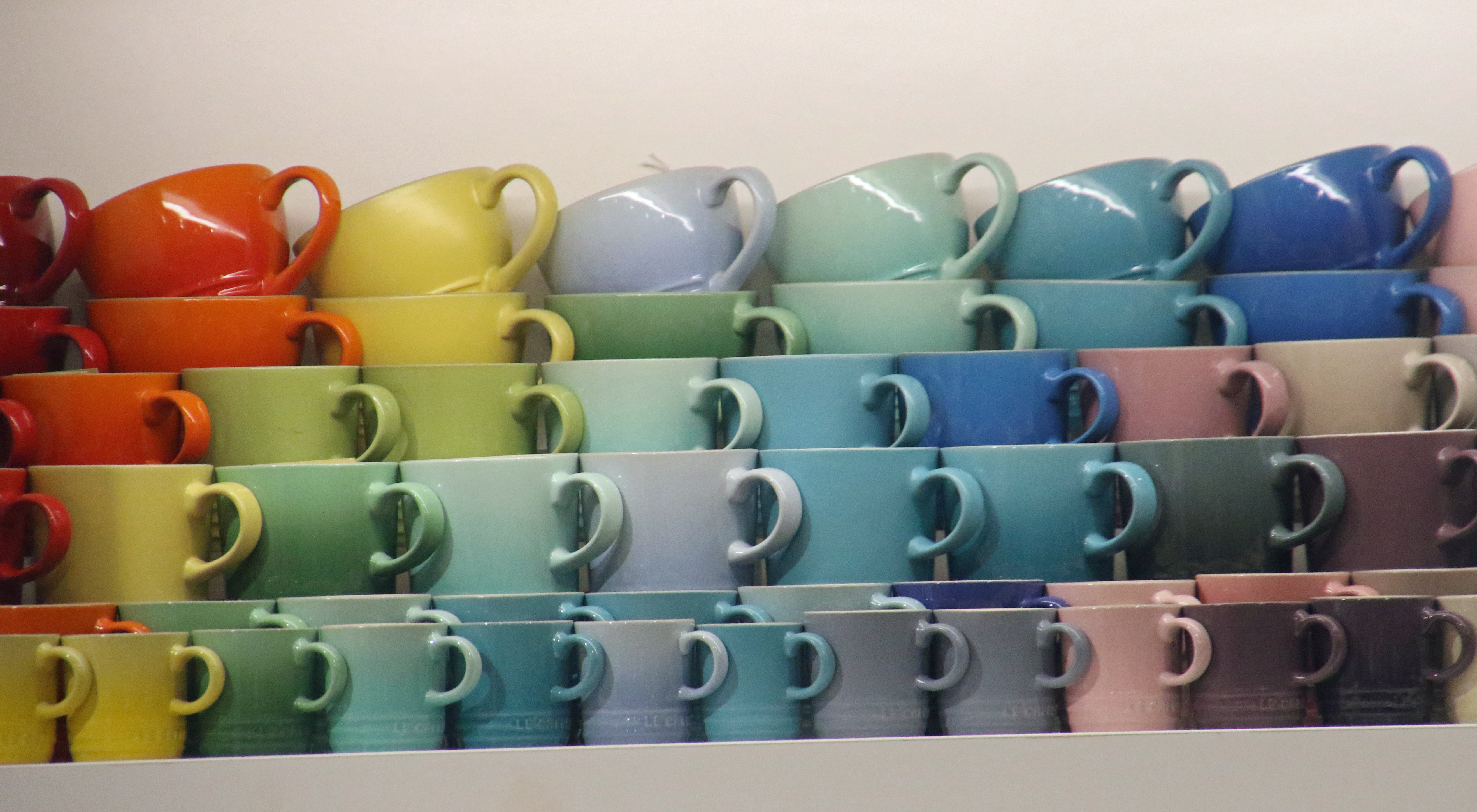 Colourful cups in the showcase photo