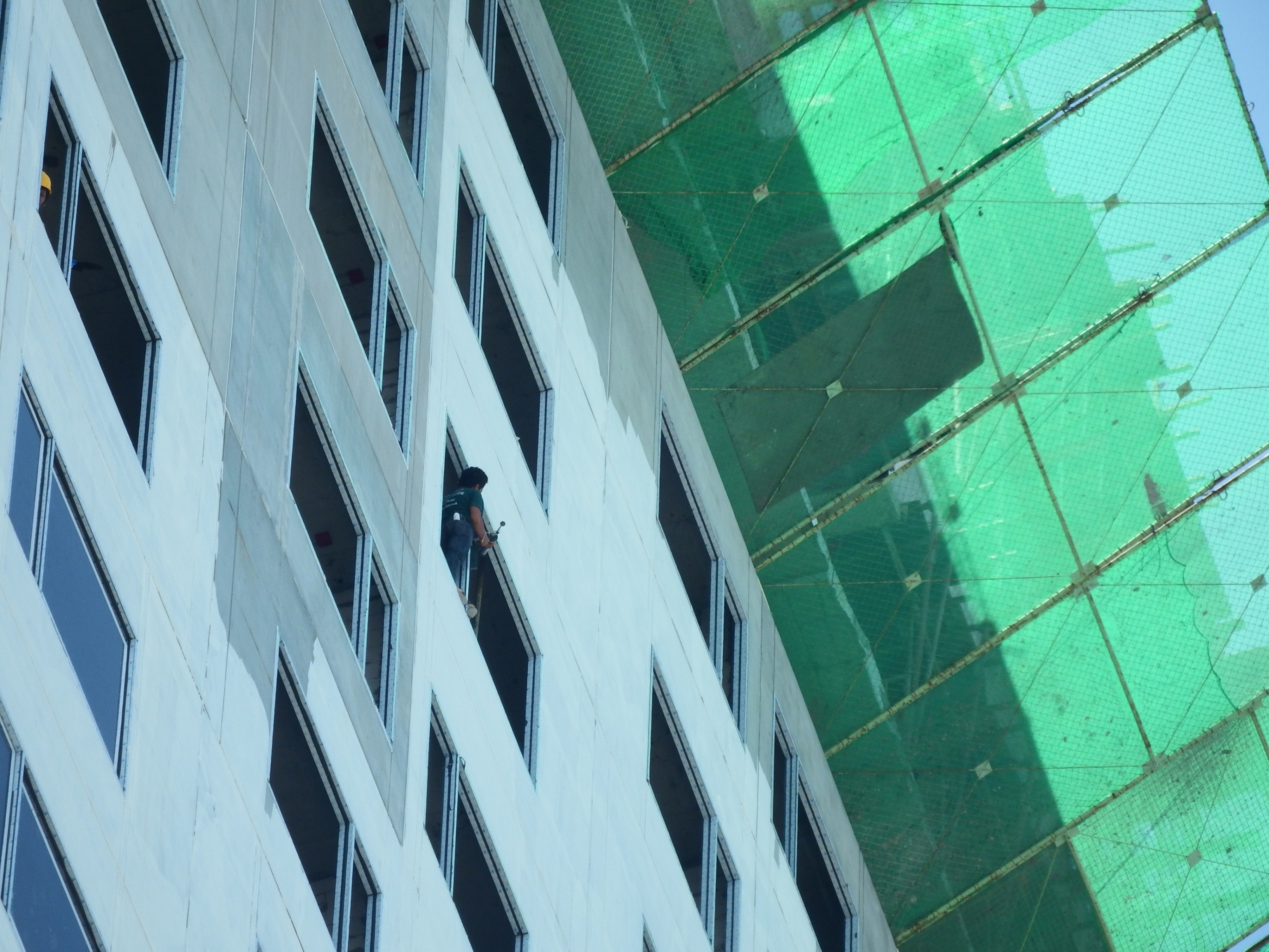 Construction worker high up photo