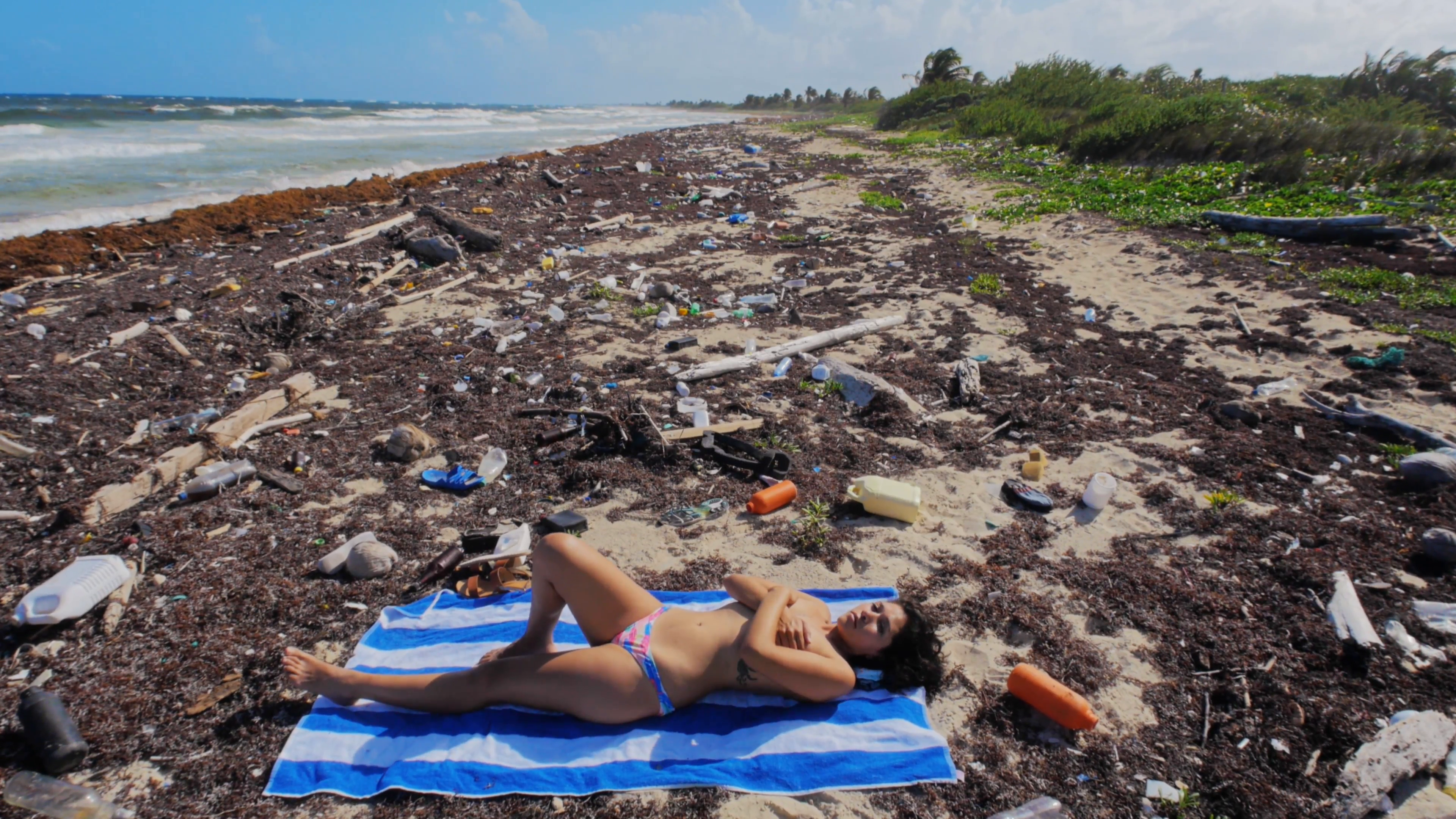 Hispanic model posing for ecologic publicity of polluted beaches on ...