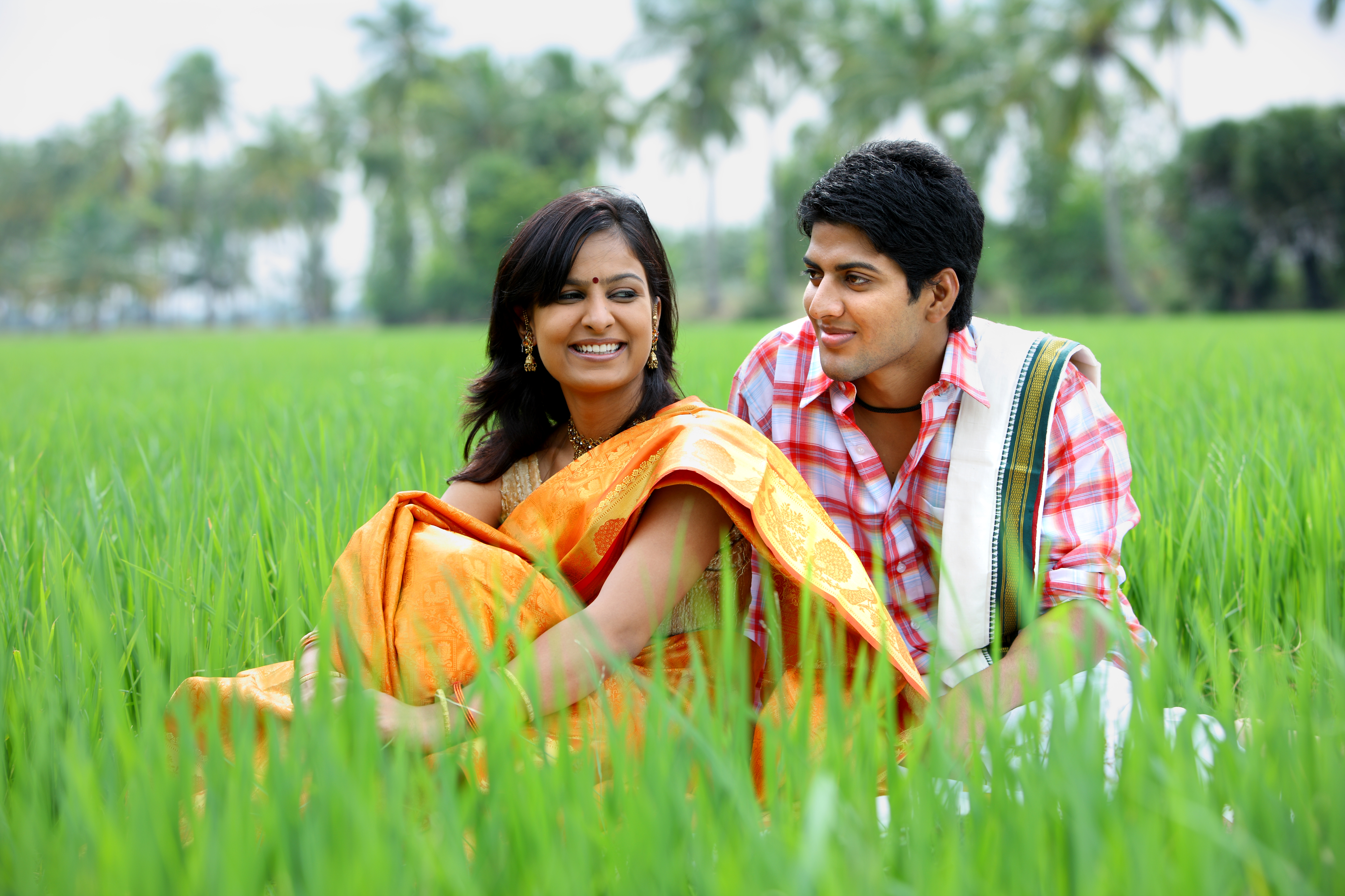 Couple sitting in a paddy field photo