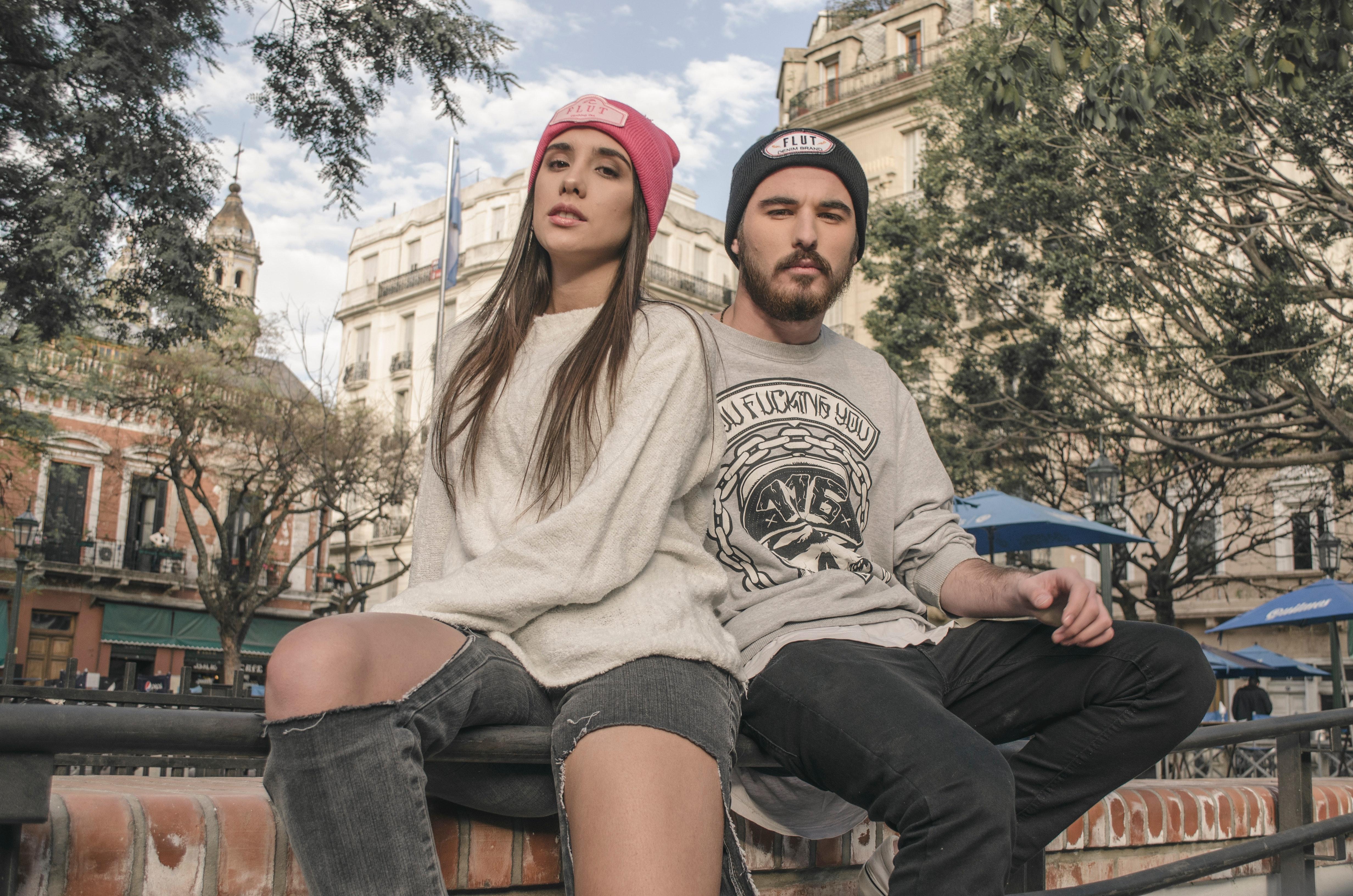 Couple sitting on raillings photo