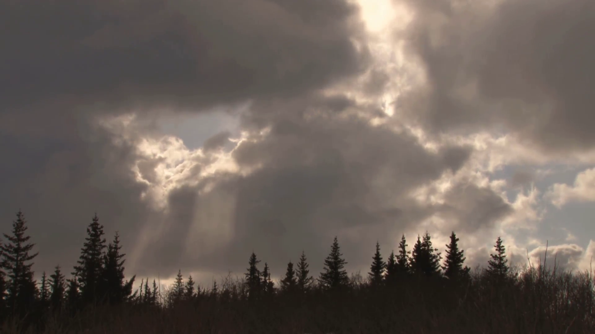 Glowing Sun Covered By Shifting Clouds Stock Video Footage - Videoblocks