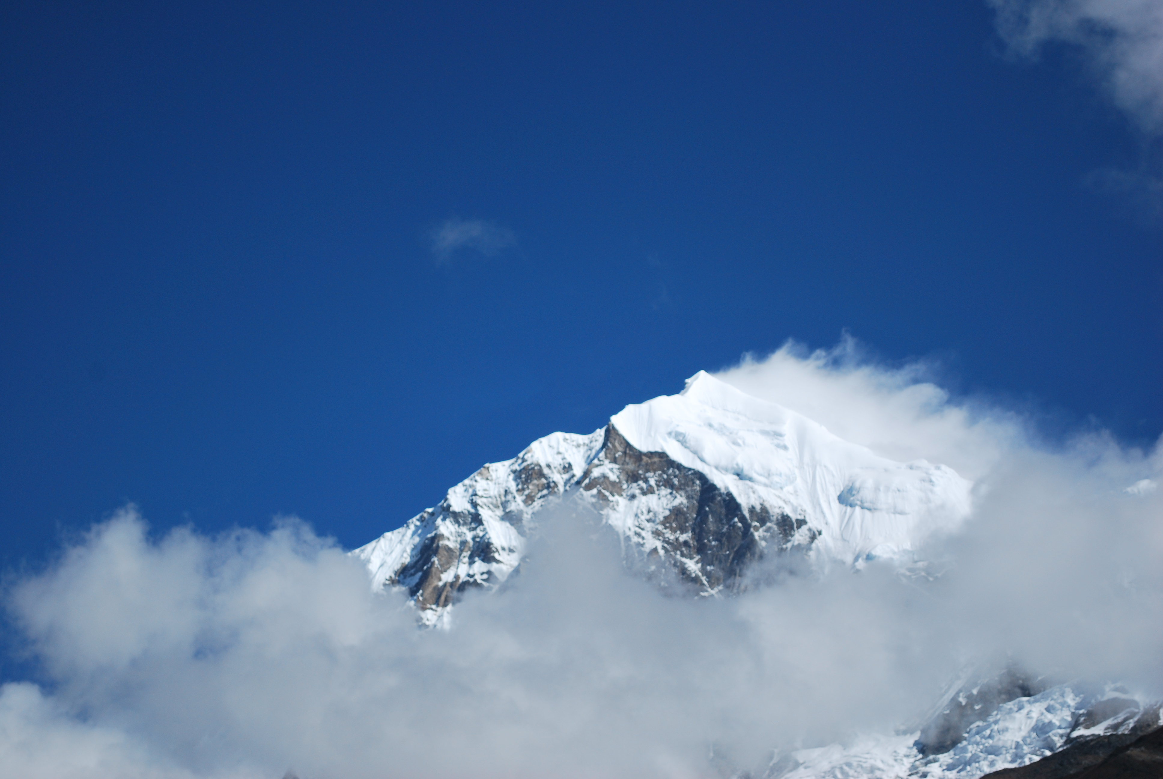 One of the five peaks of Kanchenjunga covered in clouds   Hemant ...