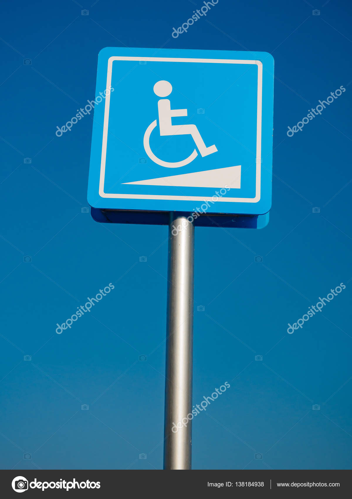 Disabled parking space and wheelchair way sign and symbols on a pole ...